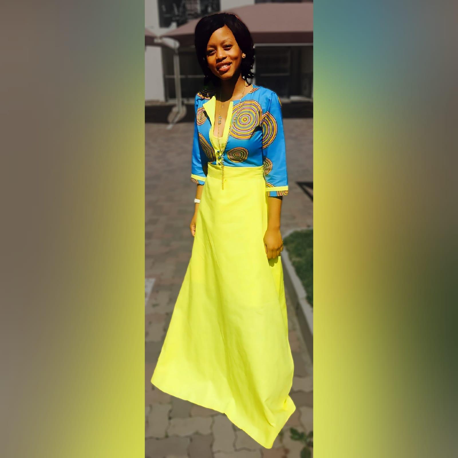 Blue & yellow modern traditional dress 5 modern traditional blue and yellow empire fit dress. Flowy bottom, neckline with a slit.