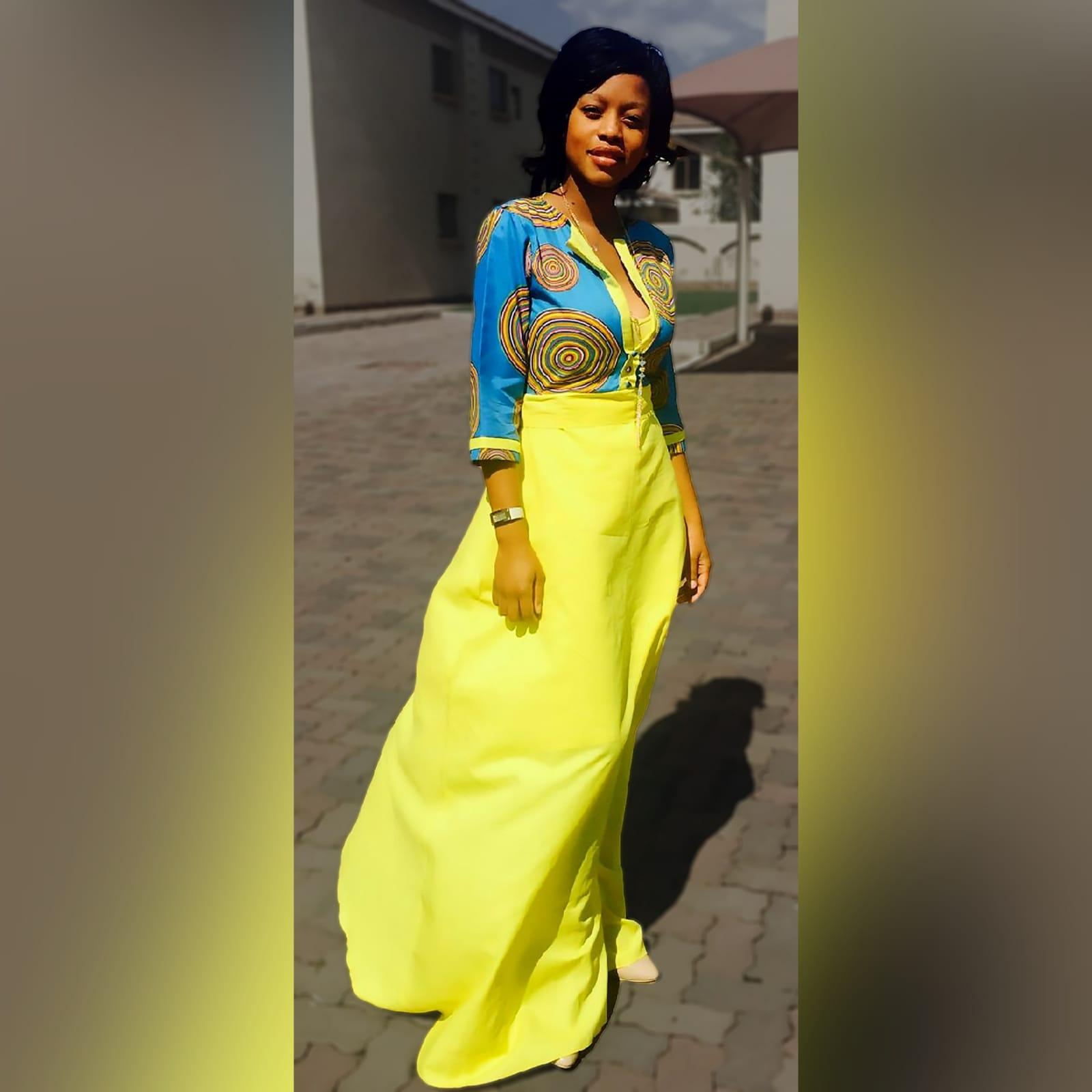 Blue & yellow modern traditional dress 1 modern traditional blue and yellow empire fit dress. Flowy bottom, neckline with a slit.