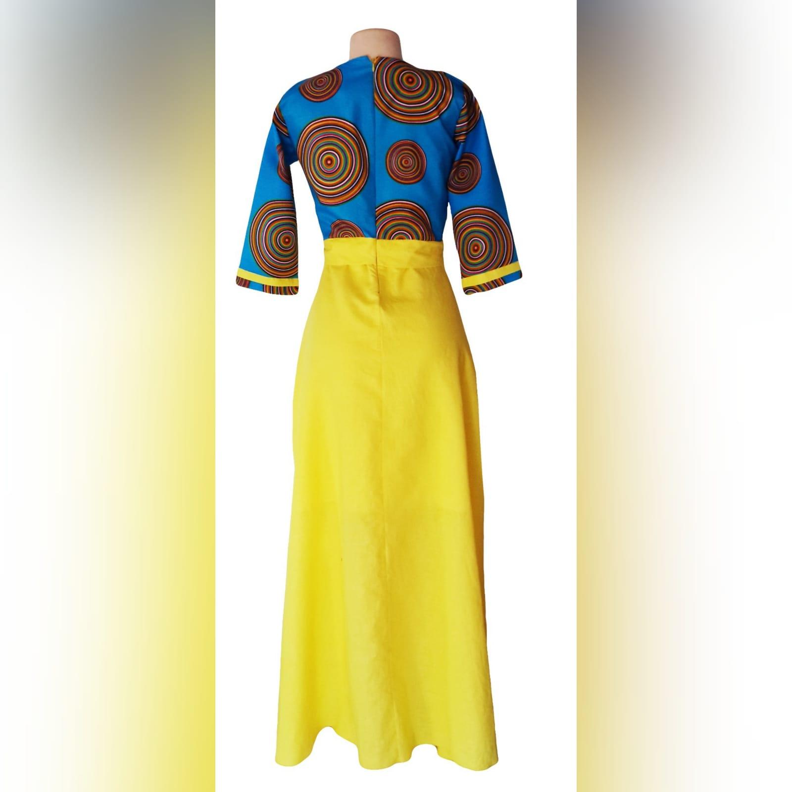Blue & yellow modern traditional dress 7 modern traditional blue and yellow empire fit dress. Flowy bottom, neckline with a slit.