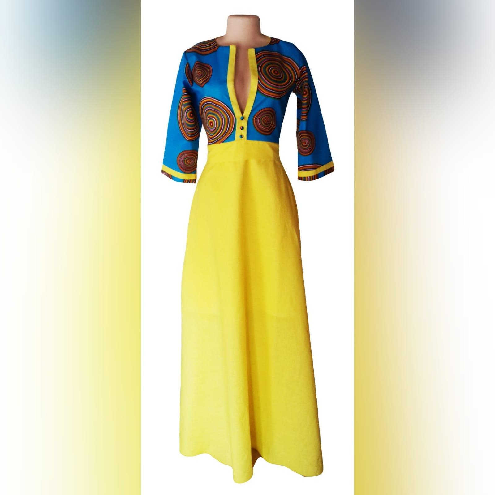 Blue & yellow modern traditional dress 8 modern traditional blue and yellow empire fit dress. Flowy bottom, neckline with a slit.