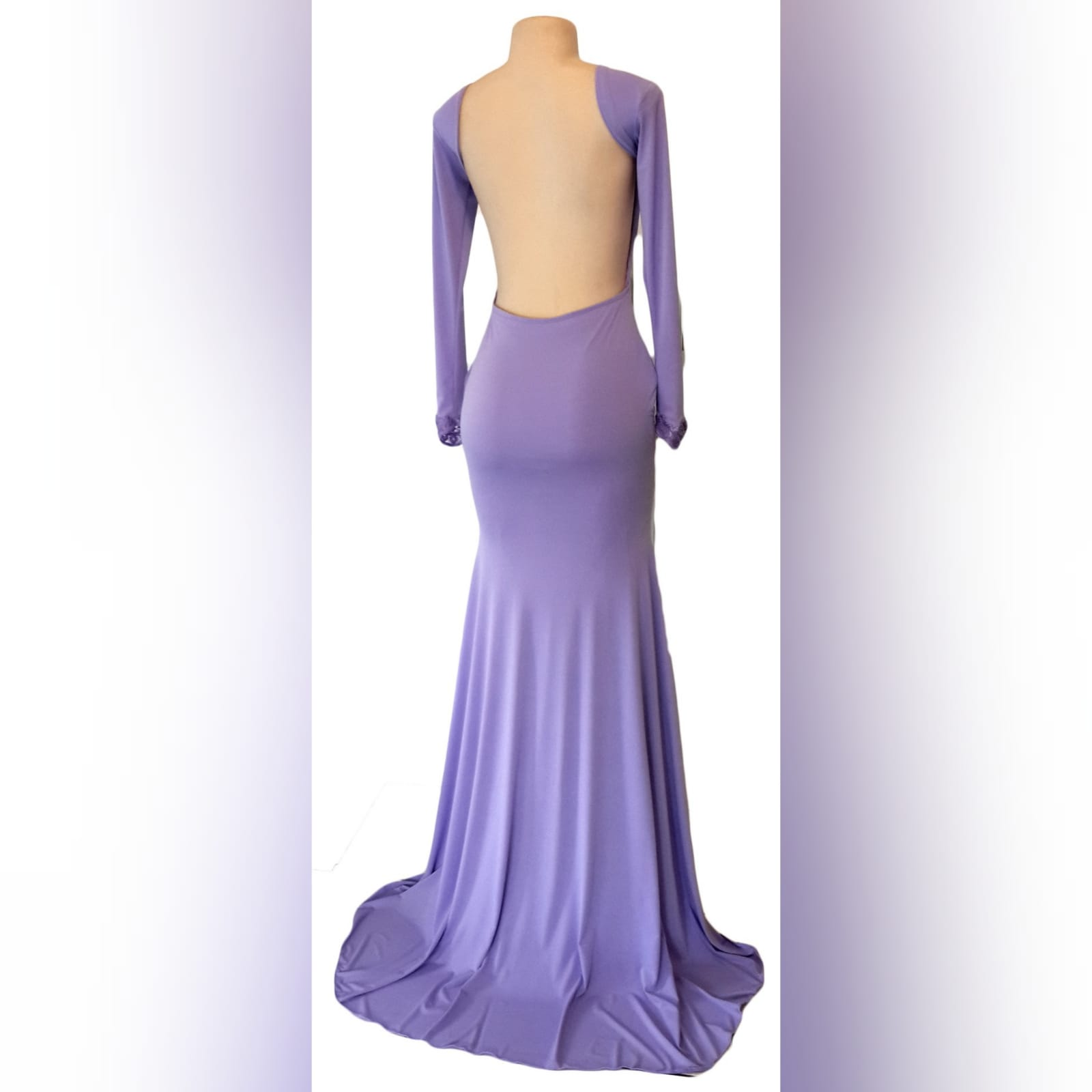 Body fitting lilac soft mermaid prom dress and a jewel neckline 6 body fitting lilac soft memaid prom dress and a jewel neckline. Low open square back. With a train and long sleeves. Sleeves finished with lace.