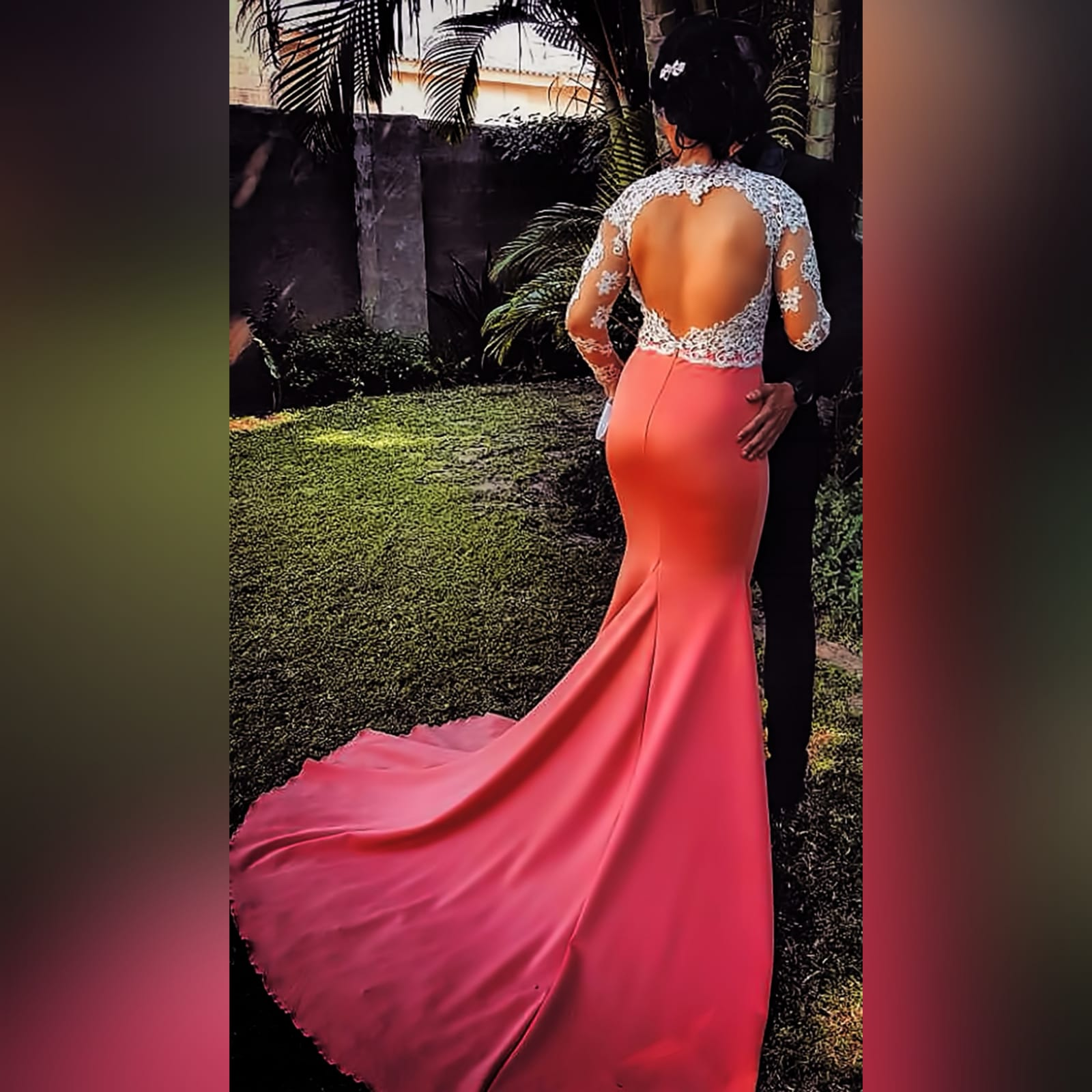 Bright coral and silver soft mermaid prom dress 5 bright coral and silver soft mermaid prom dress with a train. Bodice detailed in silver with an open heart shaped back and long illusion lace sleeves