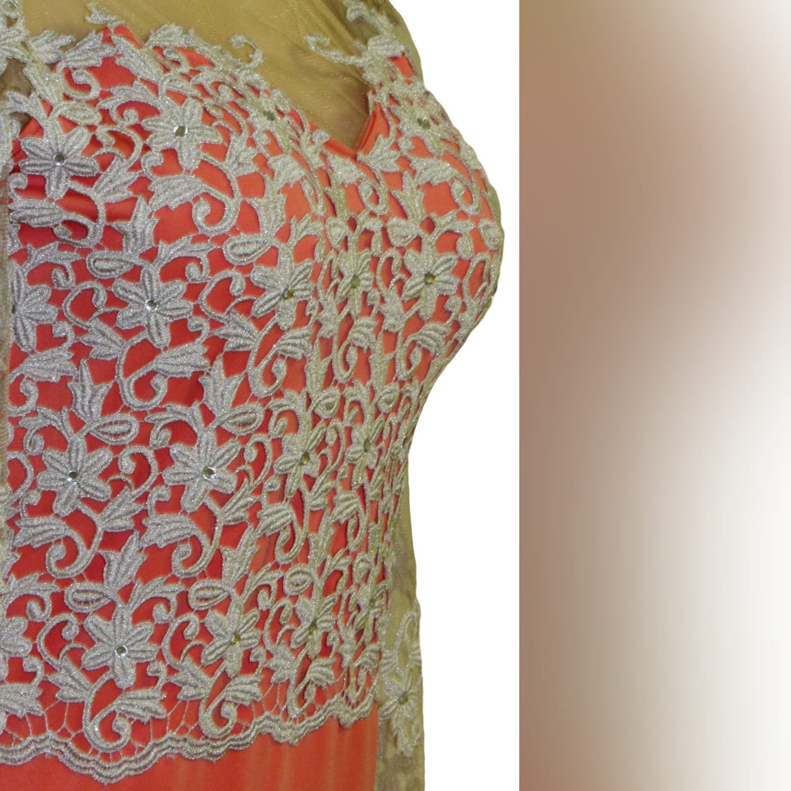 Bright coral and silver soft mermaid prom dress 8 bright coral and silver soft mermaid prom dress with a train. Bodice detailed in silver with an open heart shaped back and long illusion lace sleeves