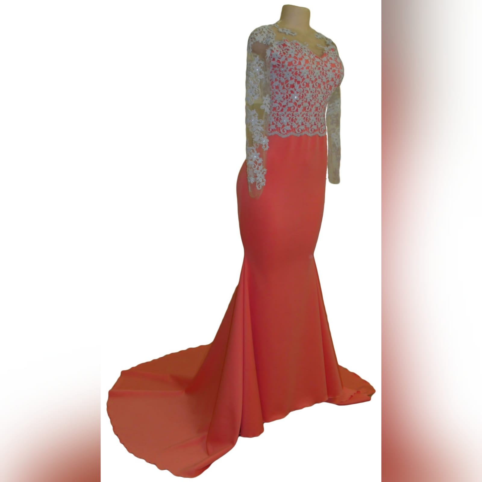 Bright coral and silver soft mermaid prom dress 2 bright coral and silver soft mermaid prom dress with a train. Bodice detailed in silver with an open heart shaped back and long illusion lace sleeves