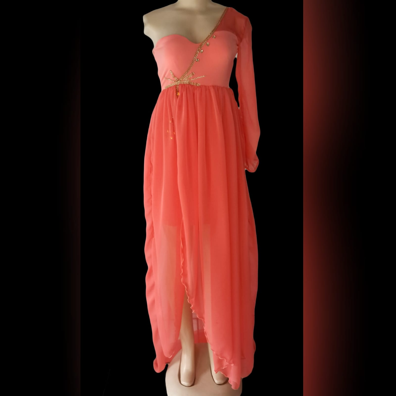 Bright coral flowy engagement dress 4 bright coral flowy engagement dress. Mini dress with a one shoulder and sleeve in chiffon, with an added gathered chiffon skirt part with a slit, dress detailed with gold bead work