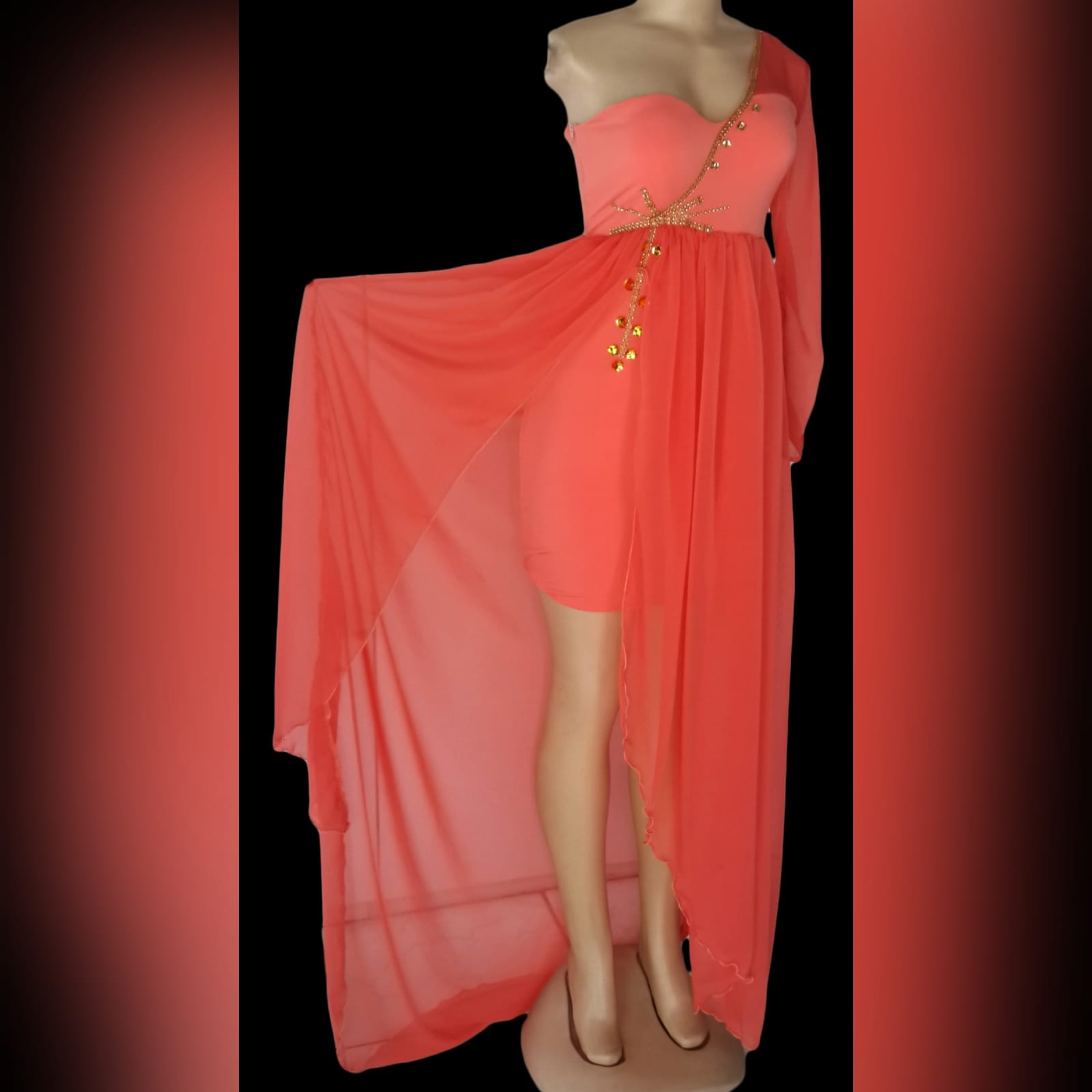 Bright coral flowy engagement dress 1 bright coral flowy engagement dress. Mini dress with a one shoulder and sleeve in chiffon, with an added gathered chiffon skirt part with a slit, dress detailed with gold bead work