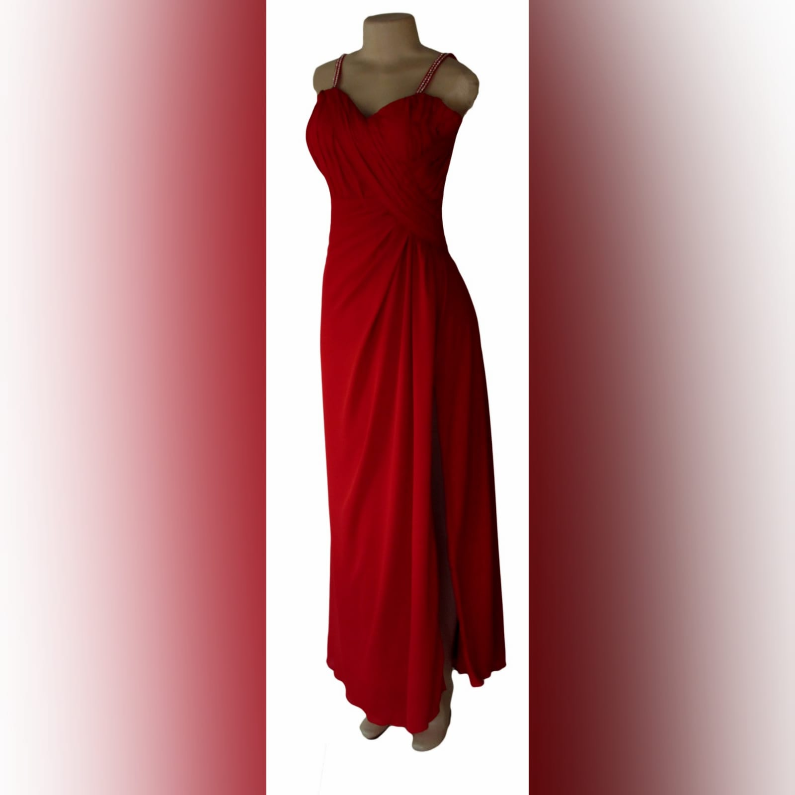 Bright red long crossed slit evening dress 3 bright red long crossed slit evening dress with a ruched bodice and hip. Shoulder straps detailed with diamante.