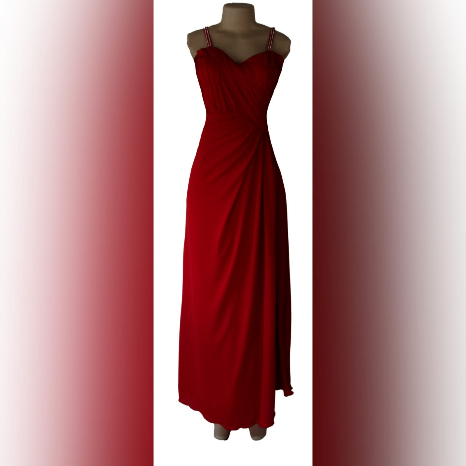 Bright red long crossed slit evening dress 1 bright red long crossed slit evening dress with a ruched bodice and hip. Shoulder straps detailed with diamante.