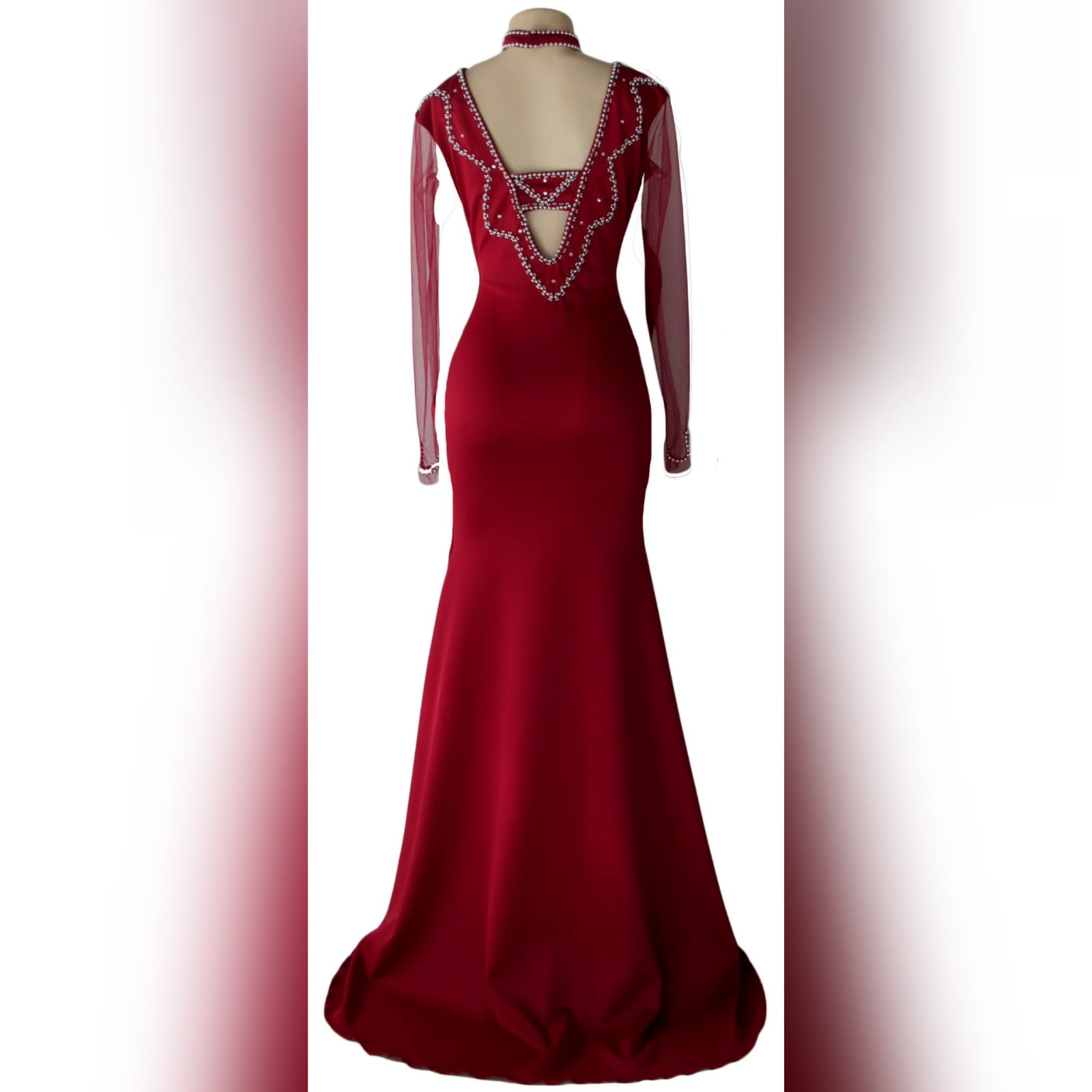 Beaded red long evening party dress 3 red long evening party dress, fitted till hip then it flares out a bit, with a train, with long sheer sleeves. Dress with a v neckline detailed in silver with an optional choker.