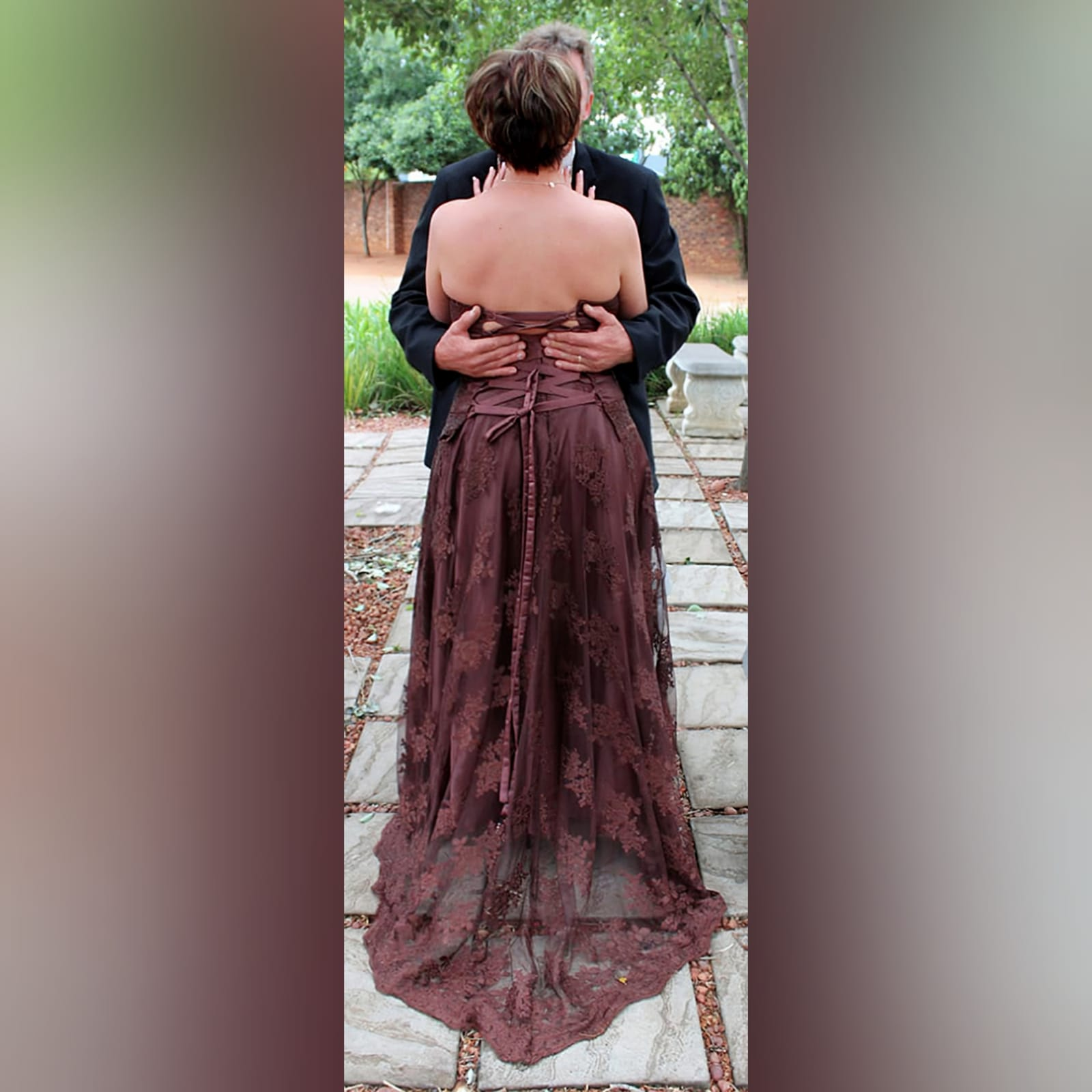 Brown 2 piece lace wedding dress 4 brown 2 piece lace wedding dress. With a flowy skirt, with train. Boob tube corset top with a lace up back.
