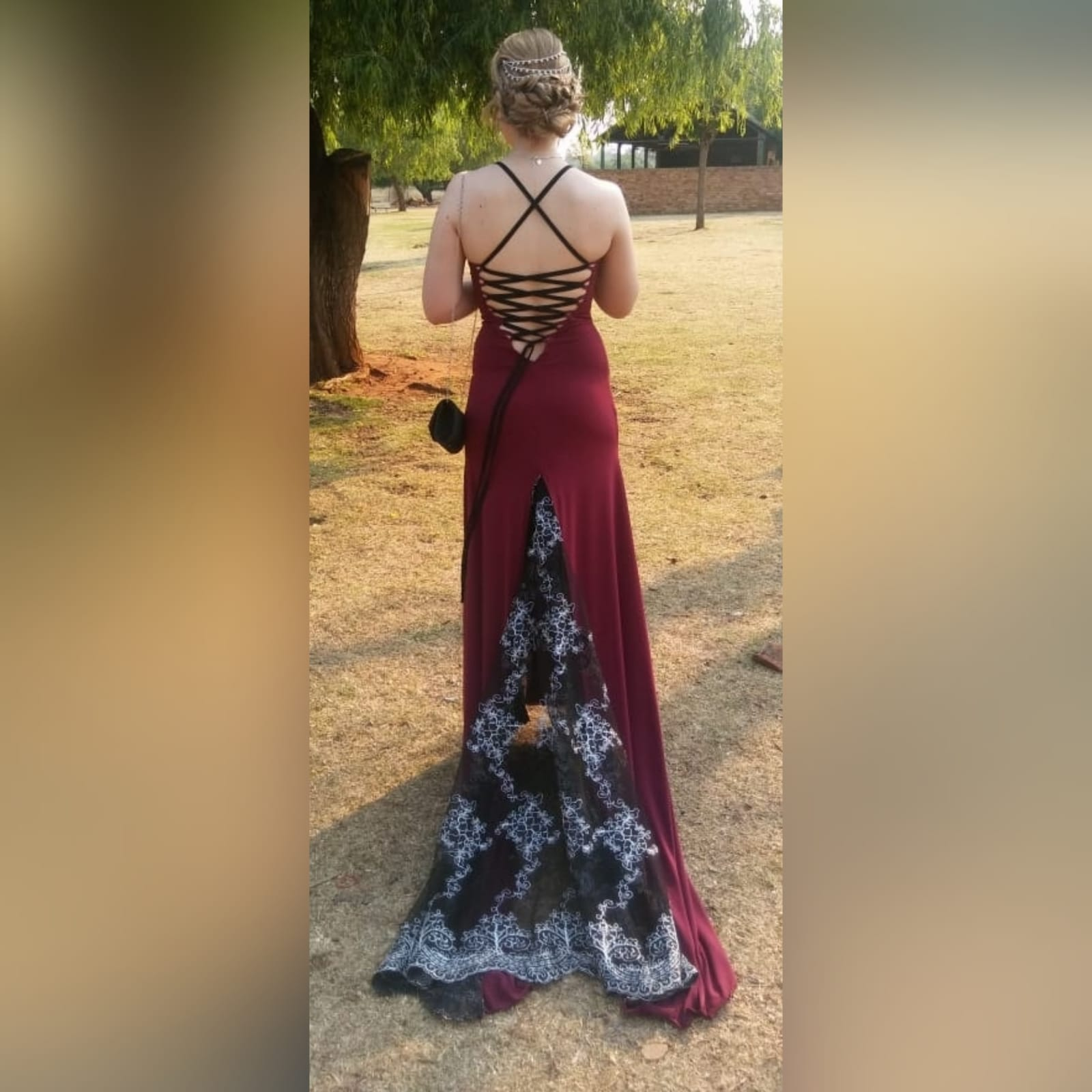 Burgundy, black and silver long sexy matric farewell dress 2 burgundy, black and silver long sexy matric farewell dress, open back with lace up detail, sheer lace train, with a slit and a v neckline.
