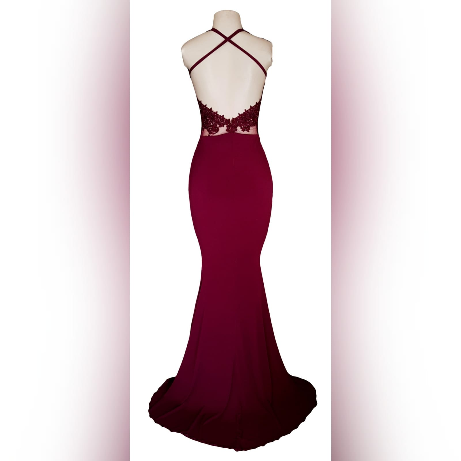 Burgundy illusion bodice soft mermaid prom dress 2 burgundy illusion bodice, soft mermaid prom dress. With a plunging neckline, low v open back with crossed straps detailed with gold beads.