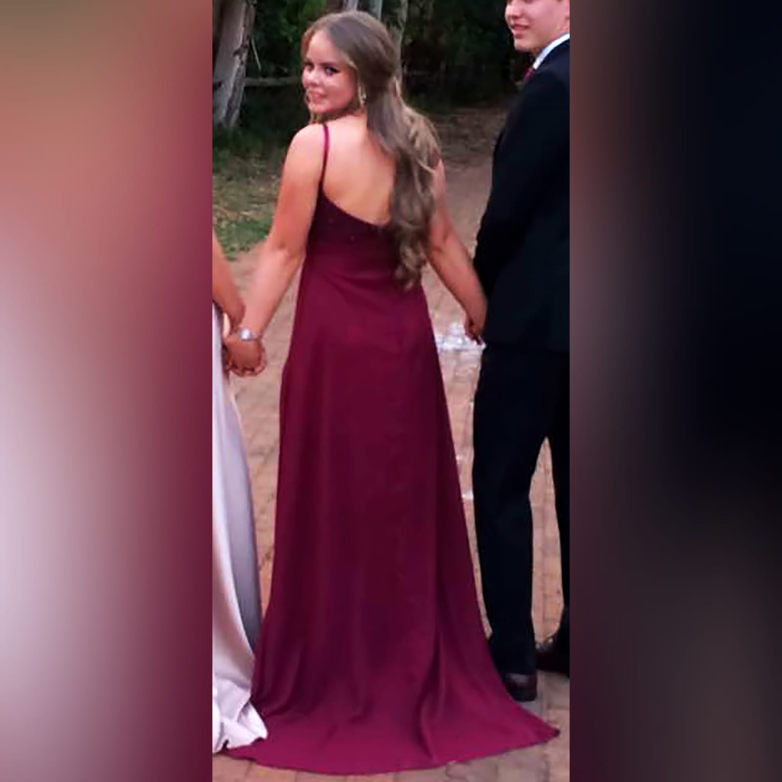 Burgundy plunging neckline long prom dress 1 burgundy plunging neckline long matric dance dress with a slit and a train. With a beaded bodice.