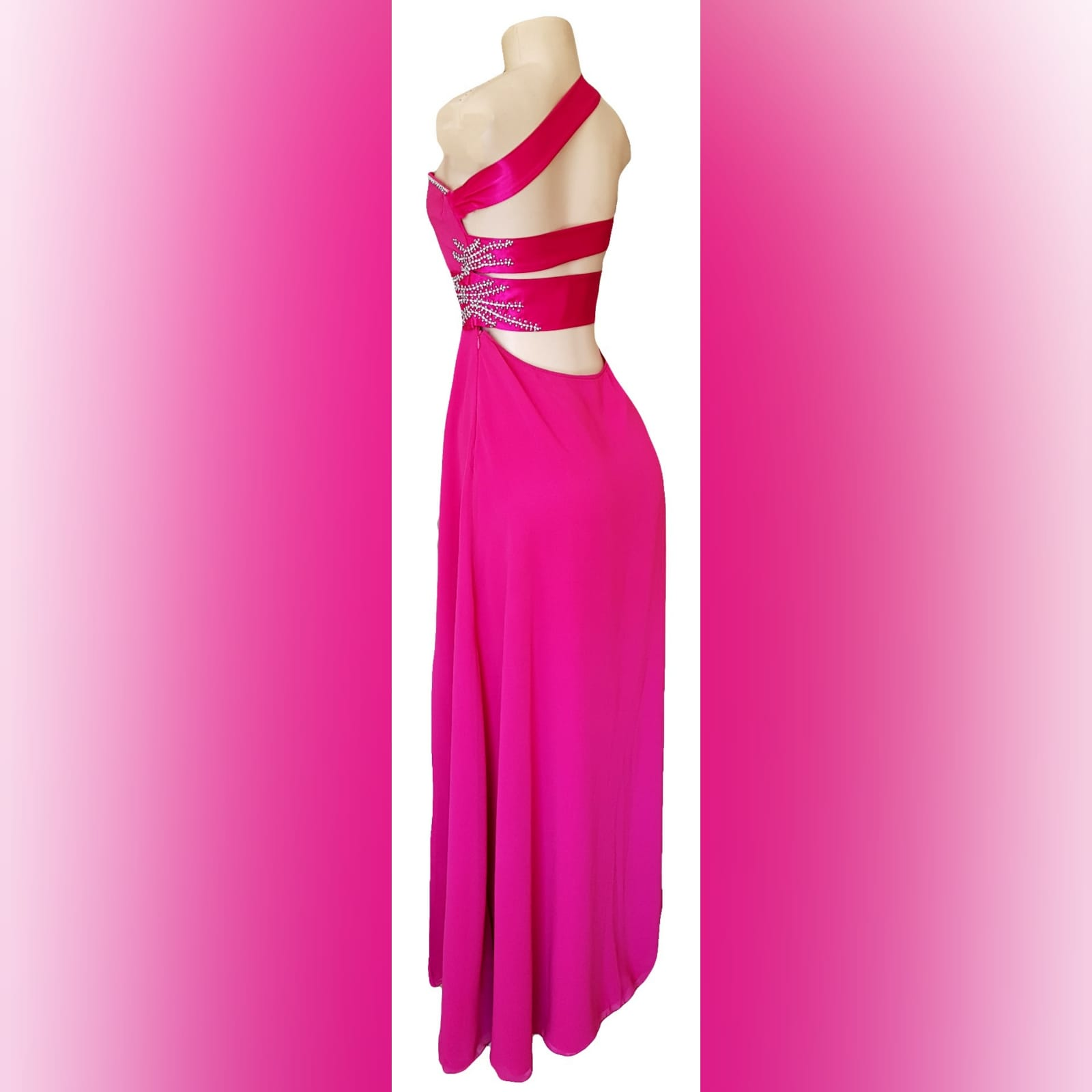 Cerise pink long flowy sexy evening dress 1 cerise pink long flowy sexy evening dress with a slit. One shoulder with a sweetheart neckline. Open back detailed with wide straps. Pleated belt. Dress beaded with silver.