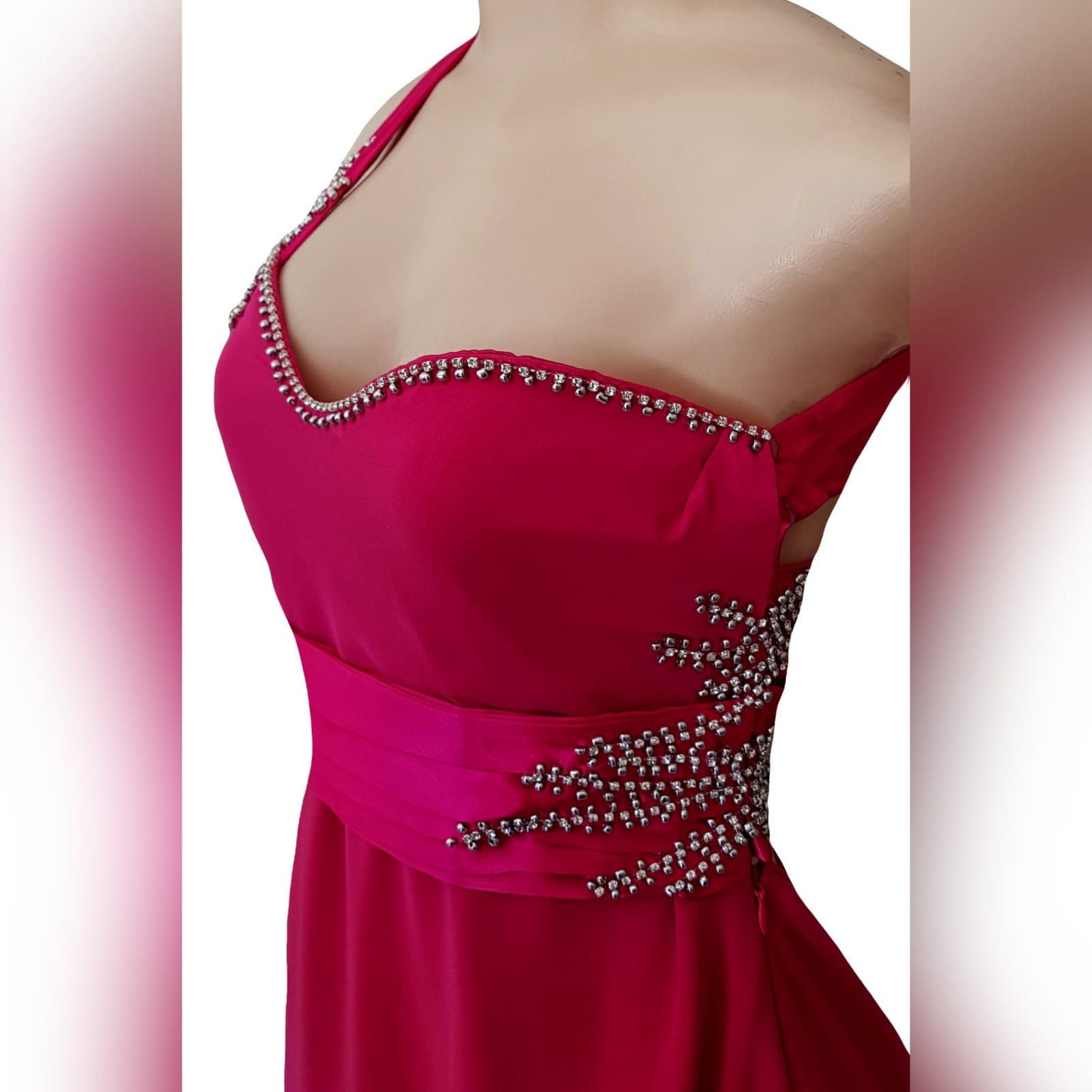 Cerise pink long flowy sexy evening dress 5 cerise pink long flowy sexy evening dress with a slit. One shoulder with a sweetheart neckline. Open back detailed with wide straps. Pleated belt. Dress beaded with silver.