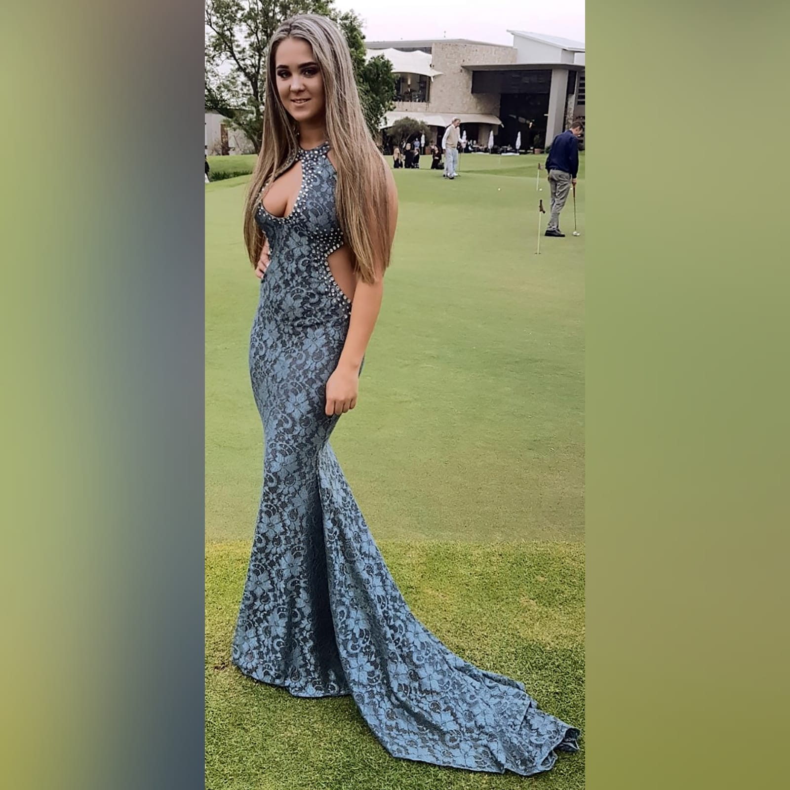 Choker gray fully laced long prom dress 1 gray fully laced long prom dress with a choker neckline and a cleavage opening and side tummy openings with a train. Detailed with silver beads.