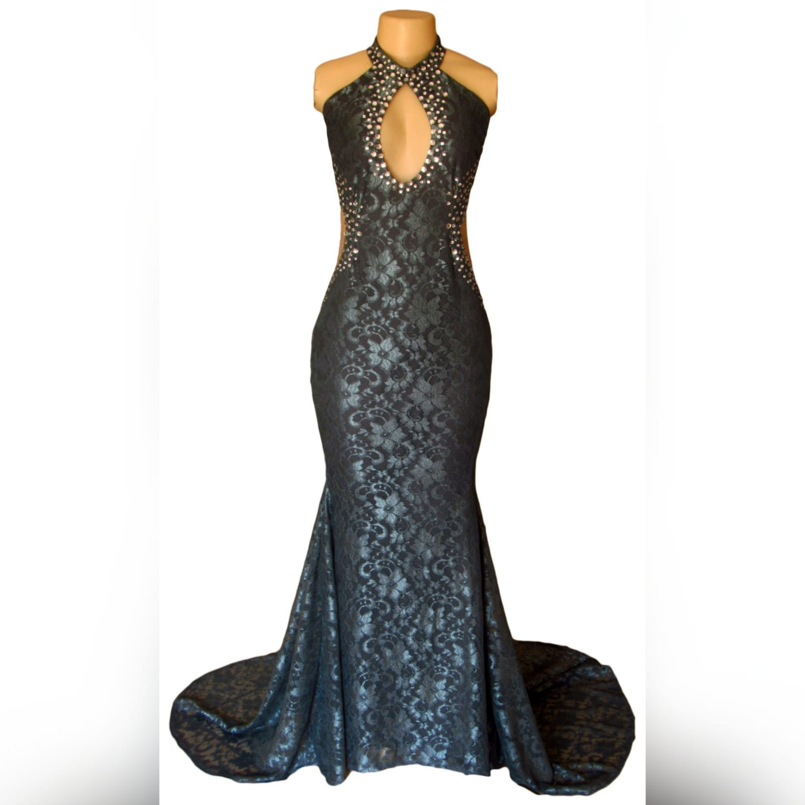Choker gray fully laced long prom dress 7 gray fully laced long prom dress with a choker neckline and a cleavage opening and side tummy openings with a train. Detailed with silver beads.