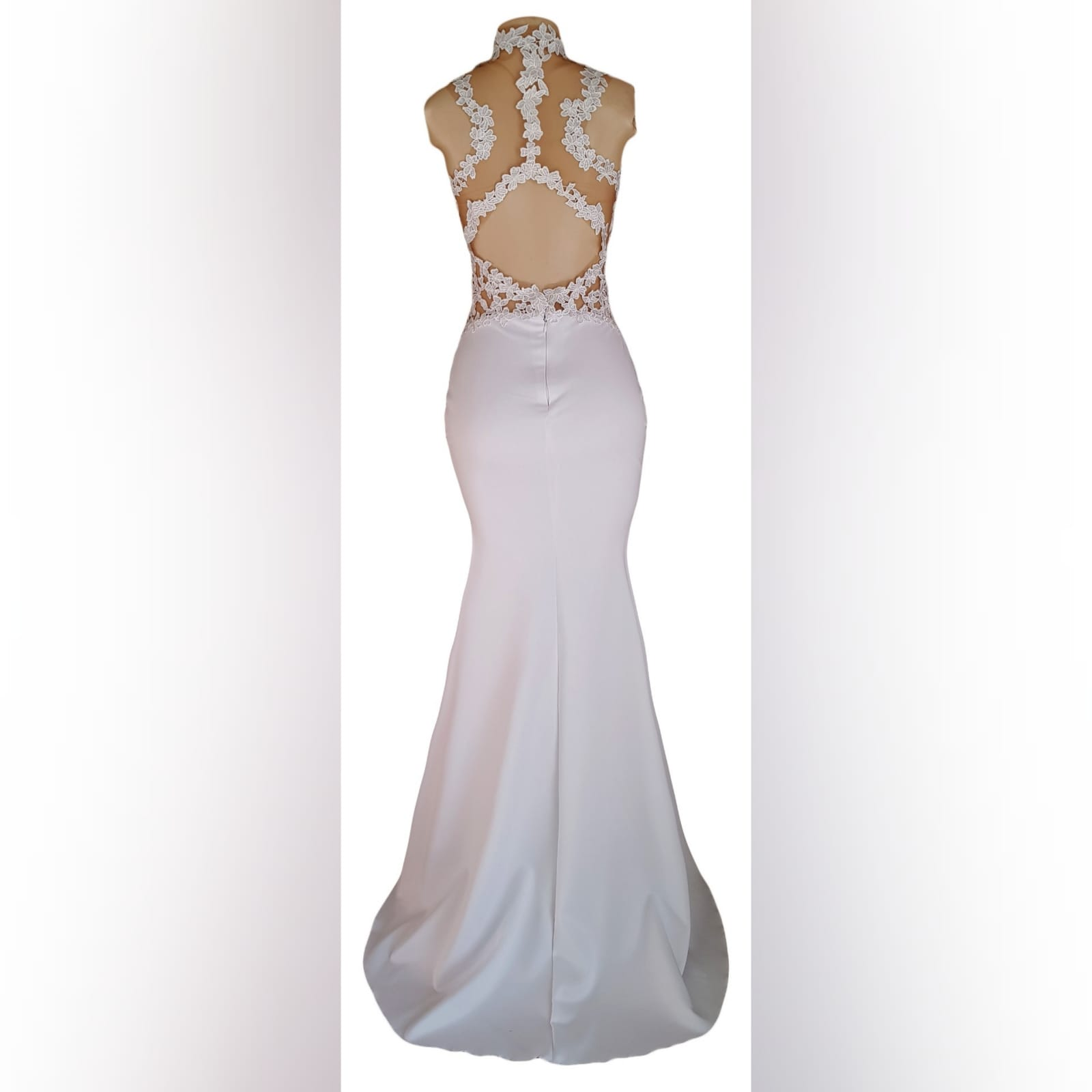 Choker white soft mermaid prom dress 4 white soft mermaid prom dress with a choker neckline and lace detail on the bodice, back & side tummy openings.
