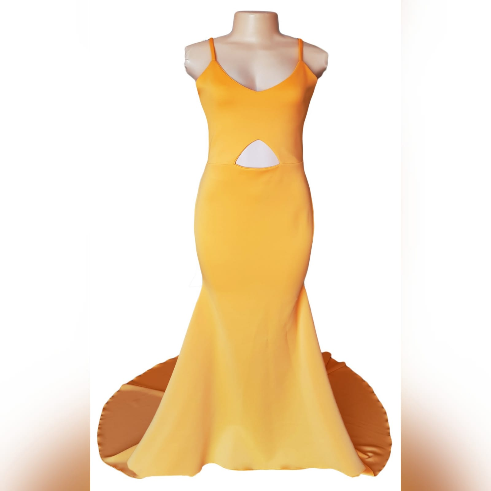 Yellow soft mermaid prom dress 8 yellow soft mermaid prom dress with a triangle tummy opening. V neckline and an open back with crossed spaghetti straps and a train.