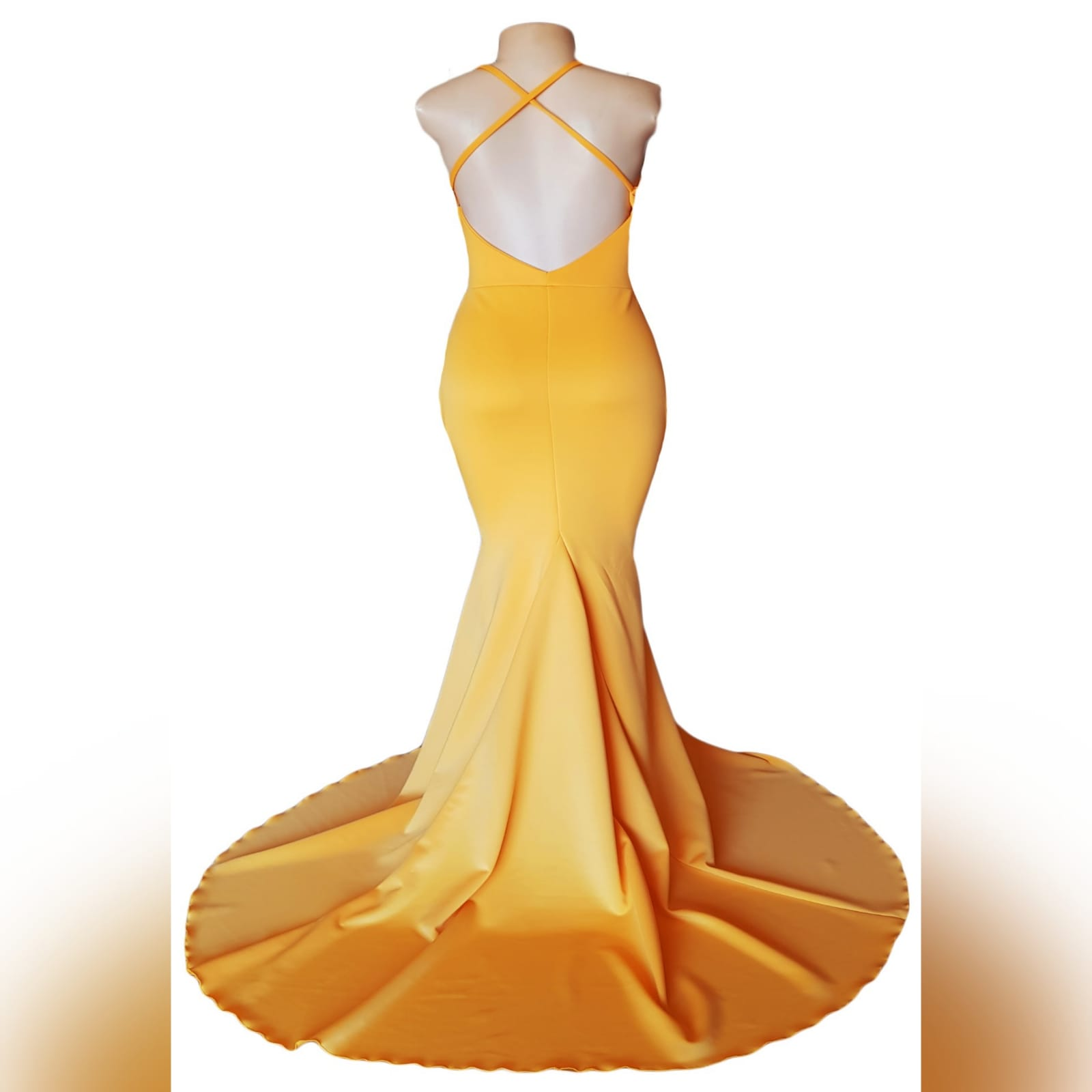 Yellow soft mermaid prom dress 7 yellow soft mermaid prom dress with a triangle tummy opening. V neckline and an open back with crossed spaghetti straps and a train.
