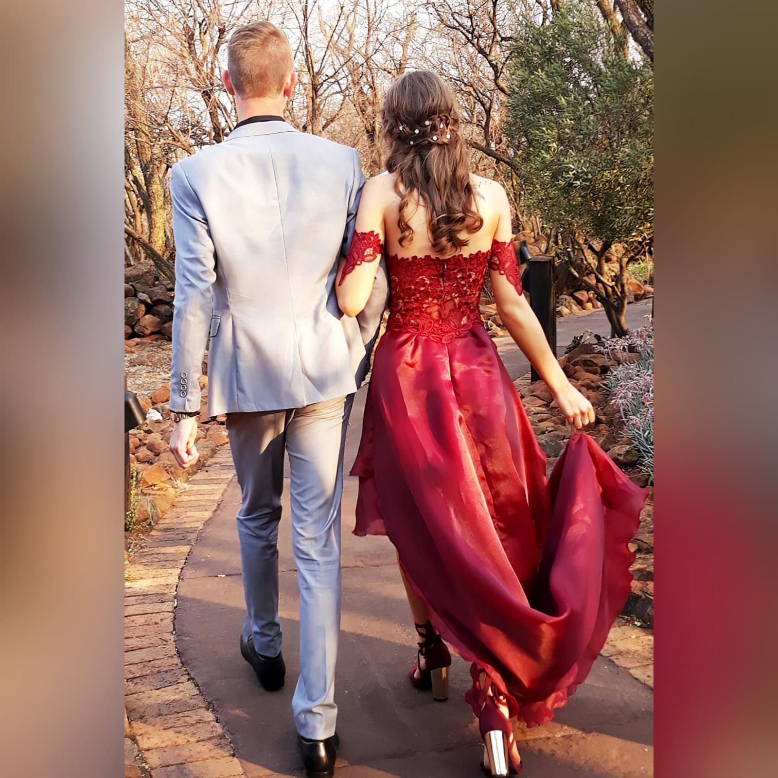 Dark red high low evening dress 4 the perfect dark red evening dress for your prom night if you want to look elegant yet adorable. With a lace bodice and a double layer hi - lo flowy bottom for a slight dramatic effect.