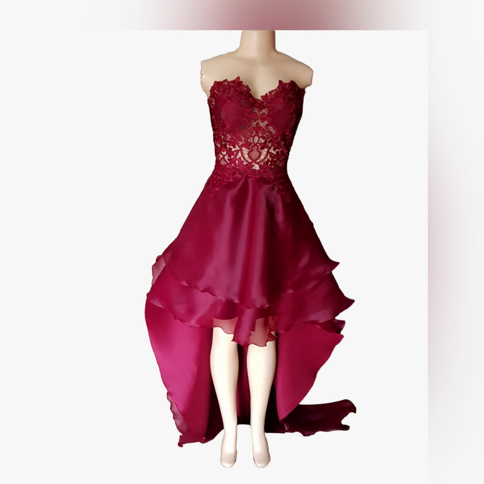 Dark red high low evening dress 7 the perfect dark red evening dress for your prom night if you want to look elegant yet adorable. With a lace bodice and a double layer hi - lo flowy bottom for a slight dramatic effect.