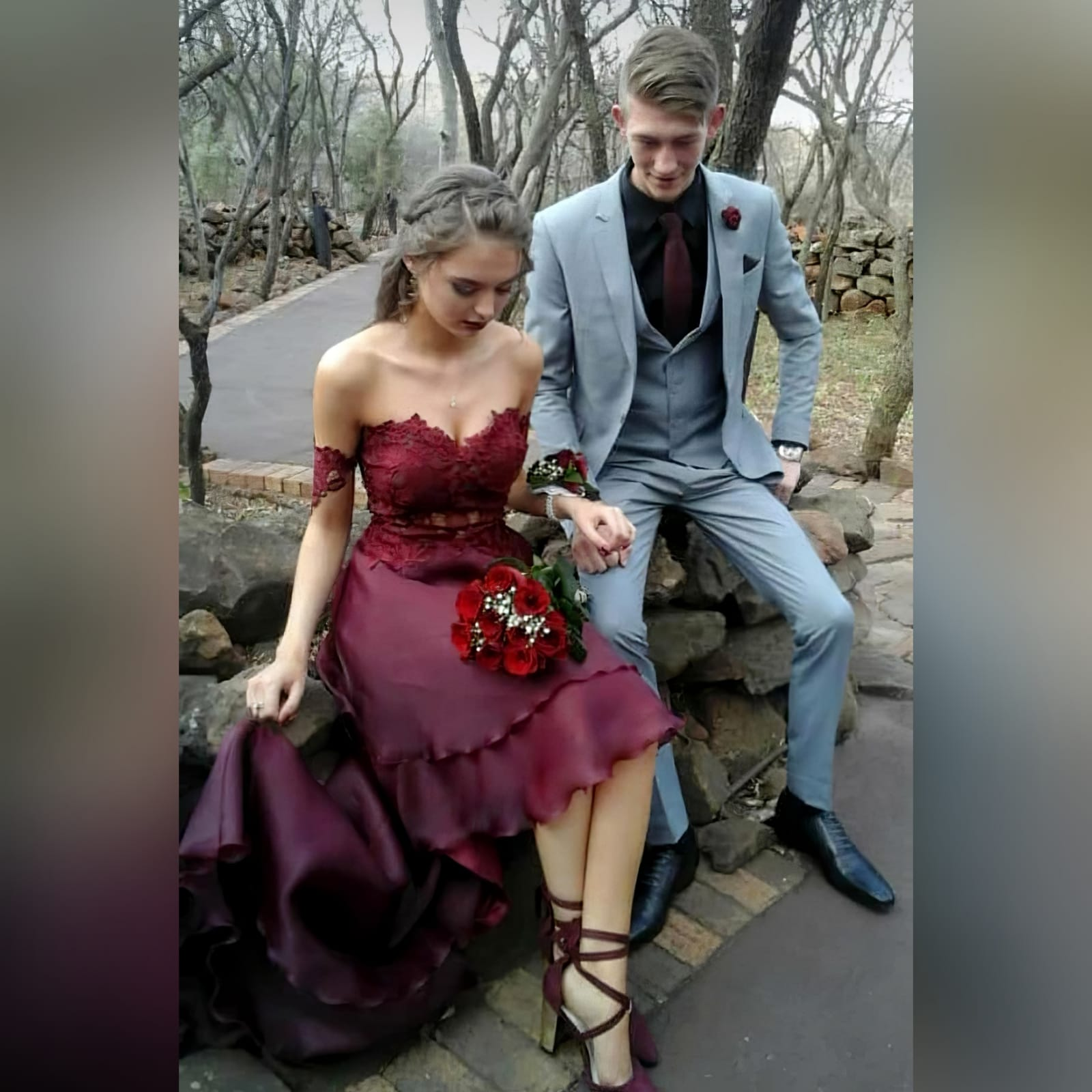 Dark red high low evening dress 9 the perfect dark red evening dress for your prom night if you want to look elegant yet adorable. With a lace bodice and a double layer hi - lo flowy bottom for a slight dramatic effect.