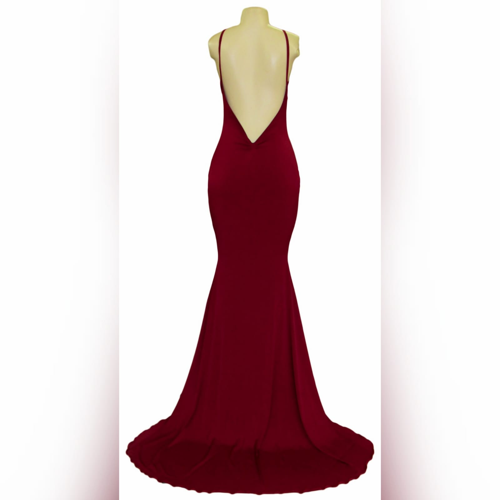 Deep red plunging neckline prom dress 11 deep red plunging neckline prom dress, low open back with thin should straps and a long train.