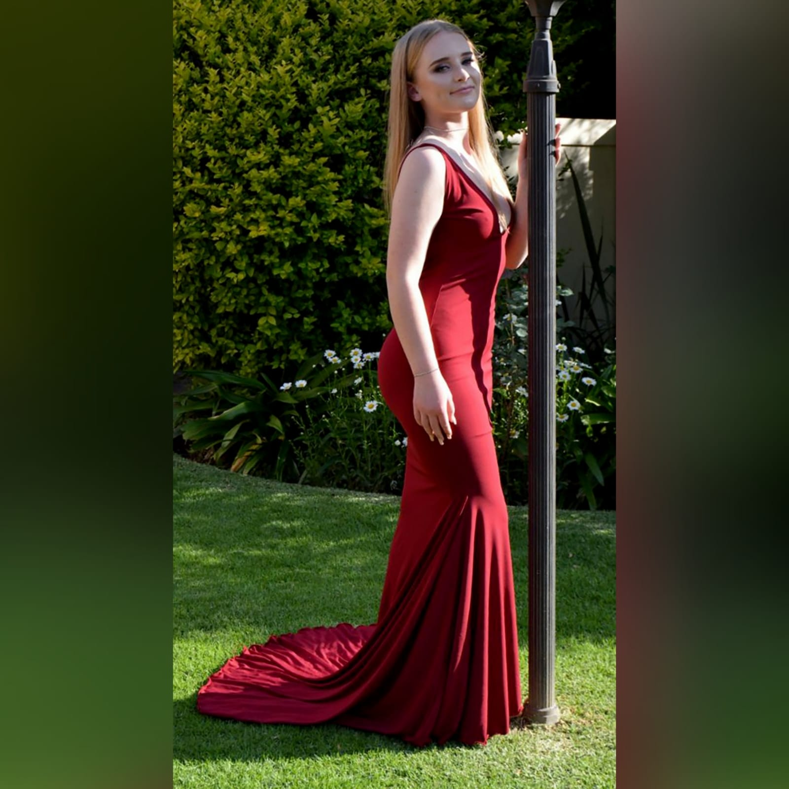 Deep red plunging neckline prom dress 3 deep red plunging neckline prom dress, low open back with thin should straps and a long train.