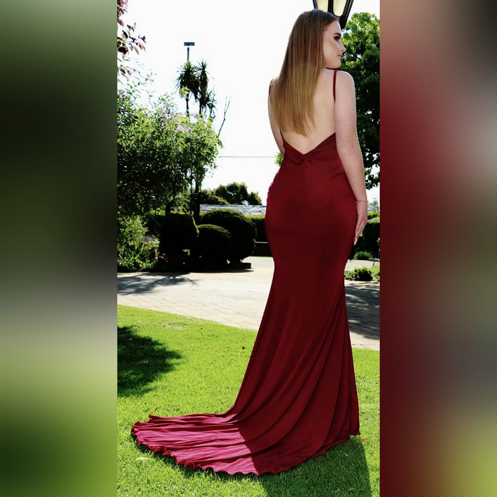 Deep red plunging neckline prom dress 5 deep red plunging neckline prom dress, low open back with thin should straps and a long train.