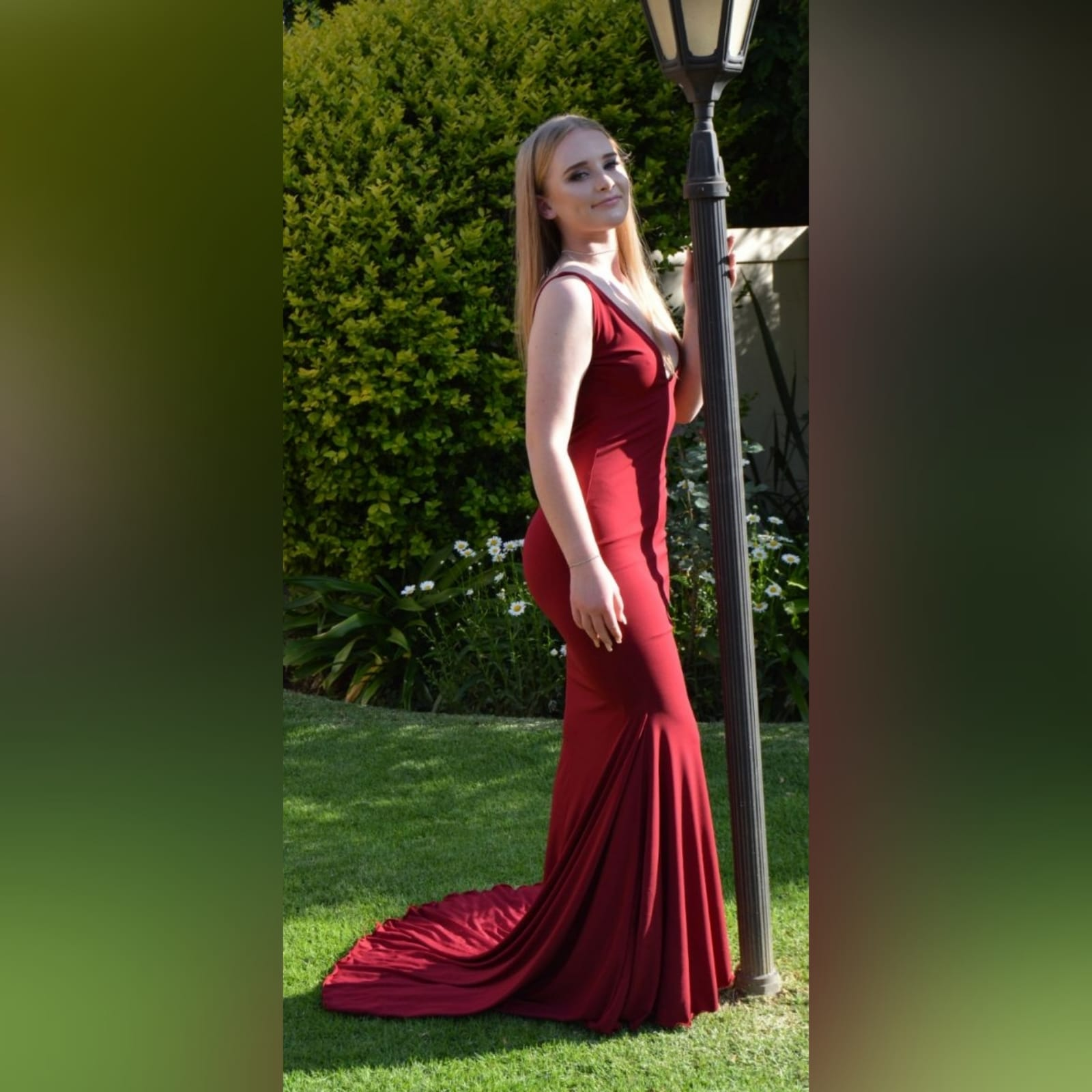 Deep red plunging neckline prom dress 1 deep red plunging neckline prom dress, low open back with thin should straps and a long train.