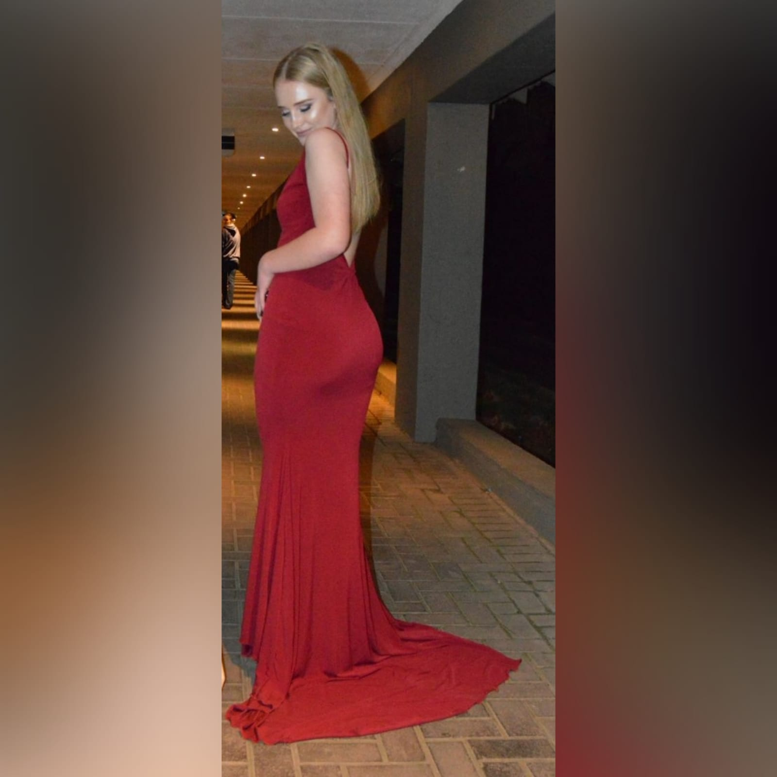 Deep red plunging neckline prom dress 9 deep red plunging neckline prom dress, low open back with thin should straps and a long train.