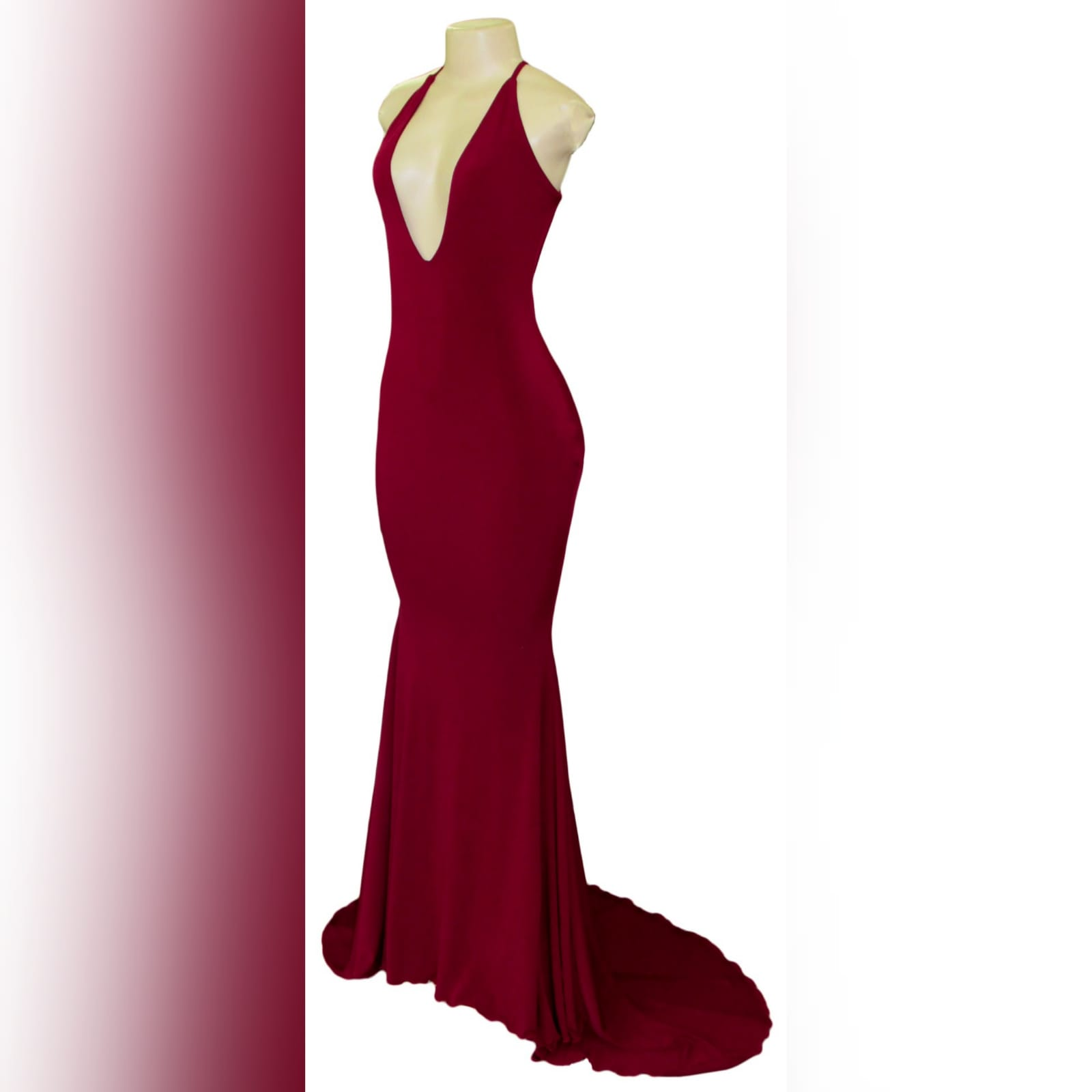 Deep red plunging neckline prom dress 10 deep red plunging neckline prom dress, low open back with thin should straps and a long train.