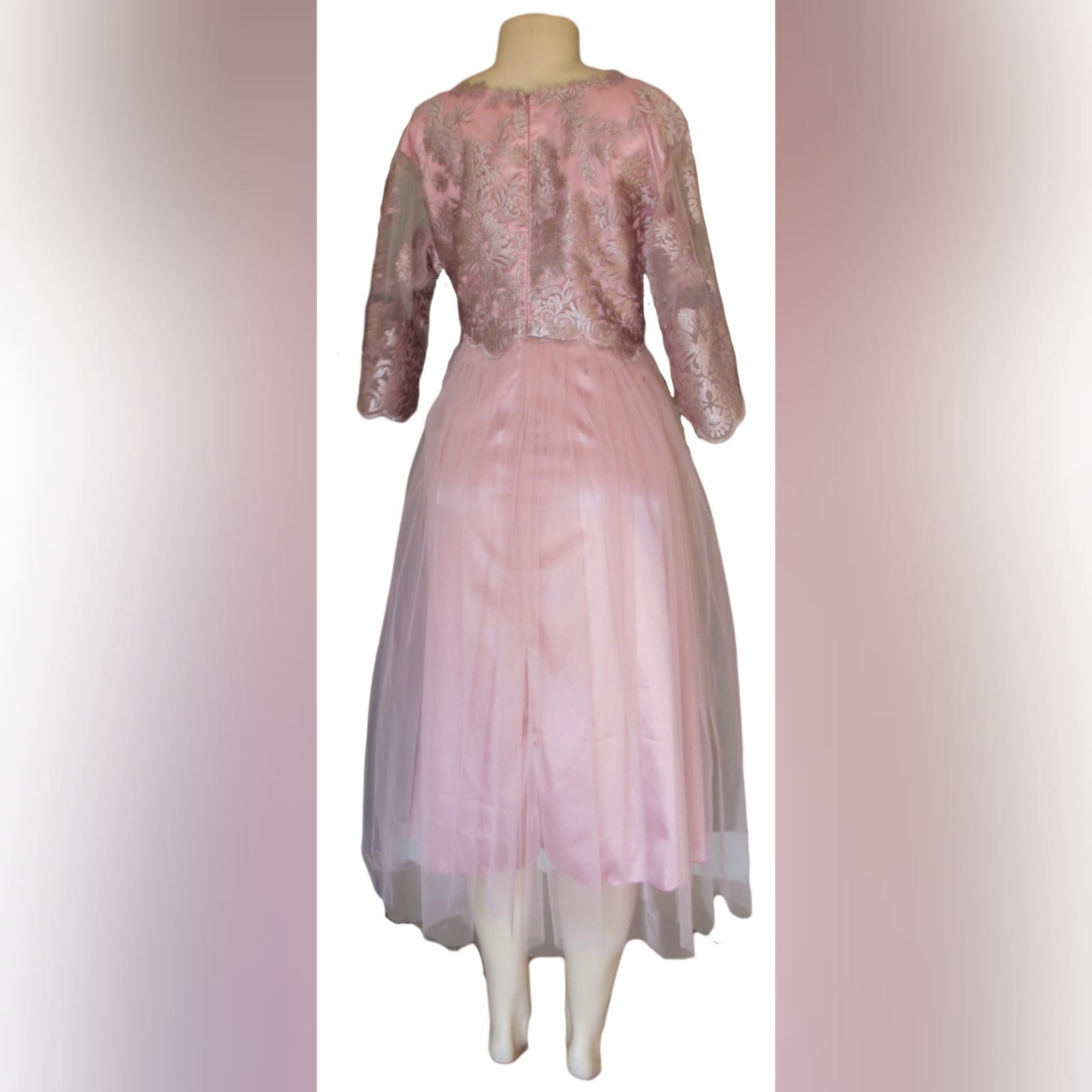 Dusty pink lace and tulle mother of the bride dress 6 dusty pink lace and tulle mother of the bride dress. Knee length with 3/4 sleeves.