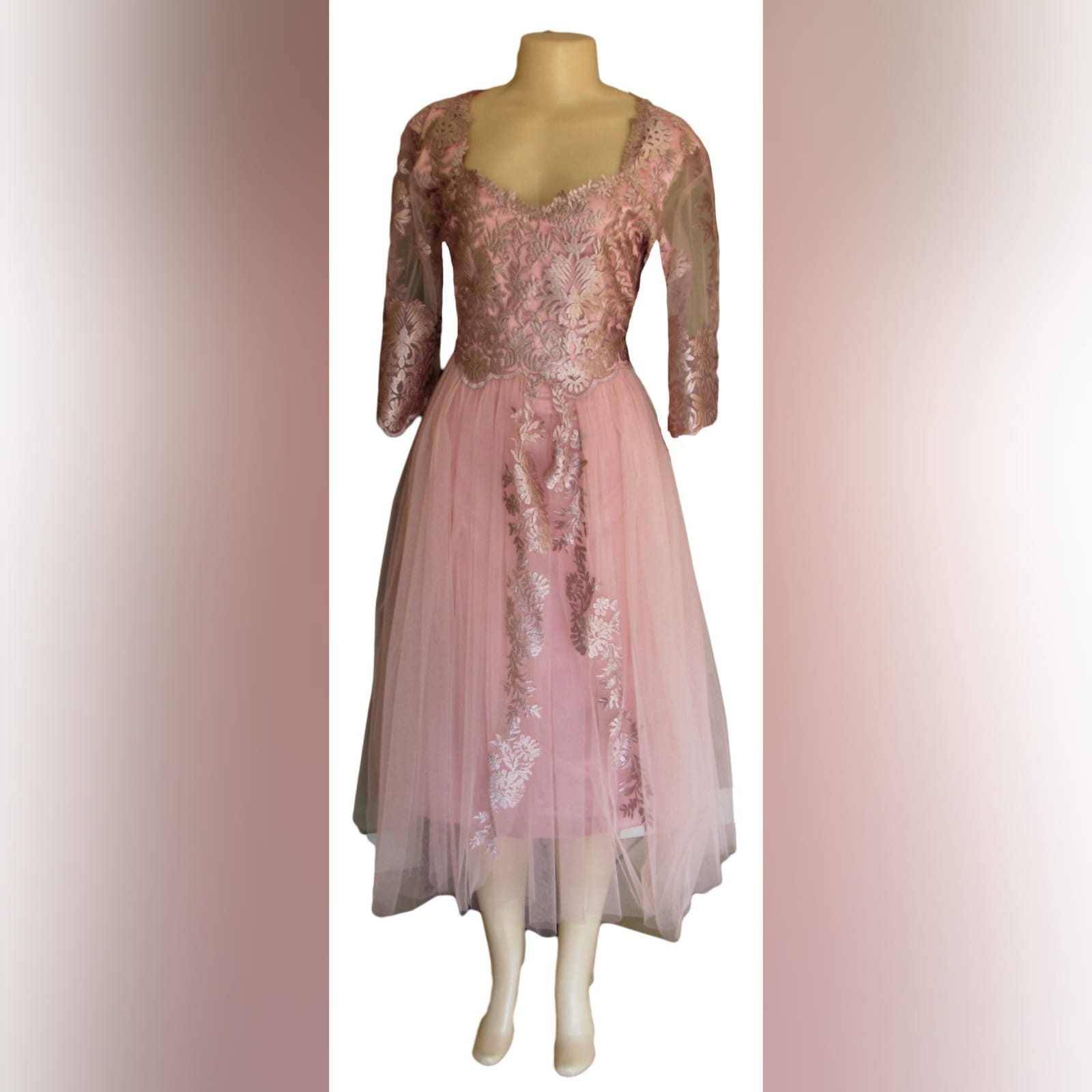 Dusty pink lace and tulle mother of the bride dress 4 dusty pink lace and tulle mother of the bride dress. Knee length with 3/4 sleeves.