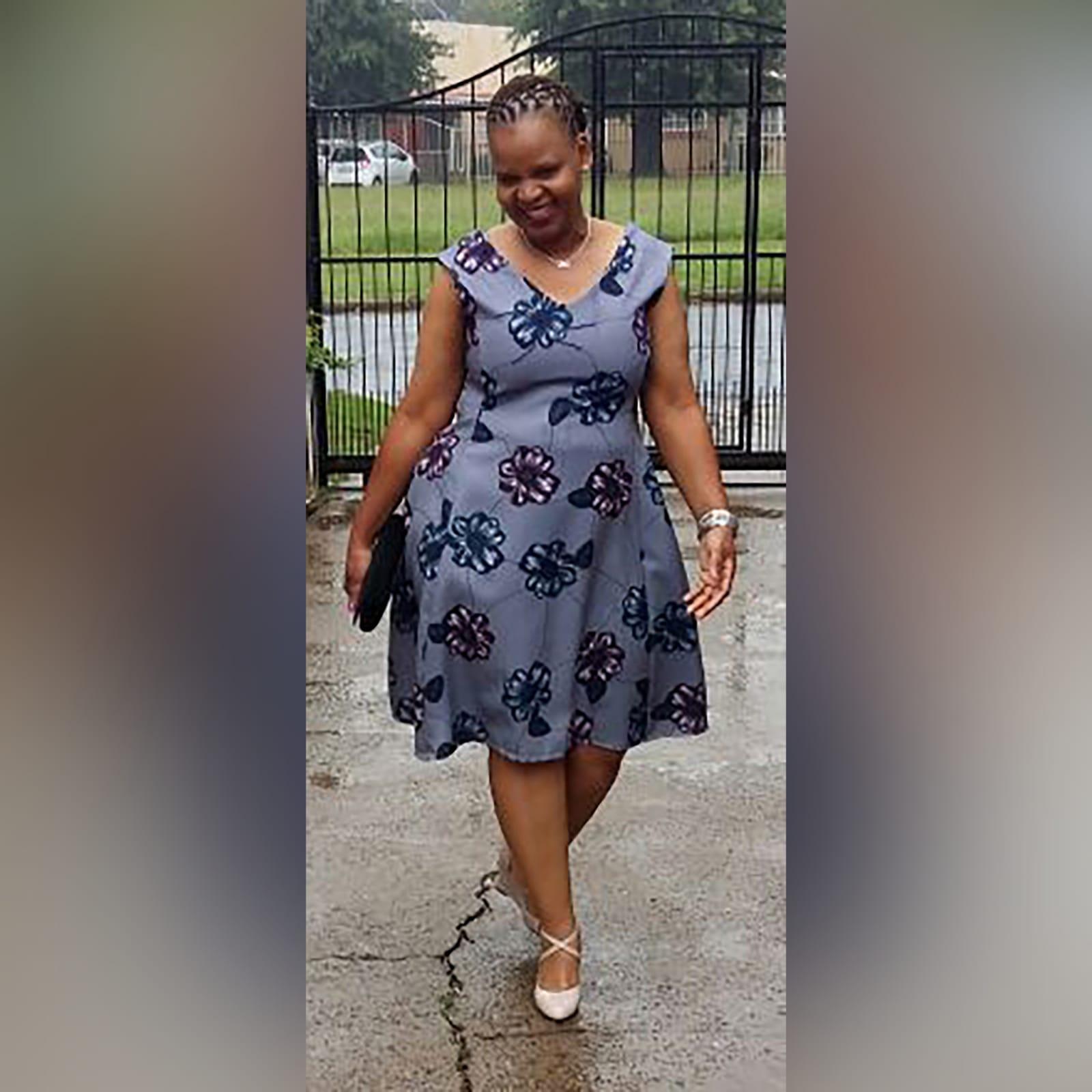 Grey floral smart casual knee length dress 1 grey floral smart casual knee length dress with a v neckline