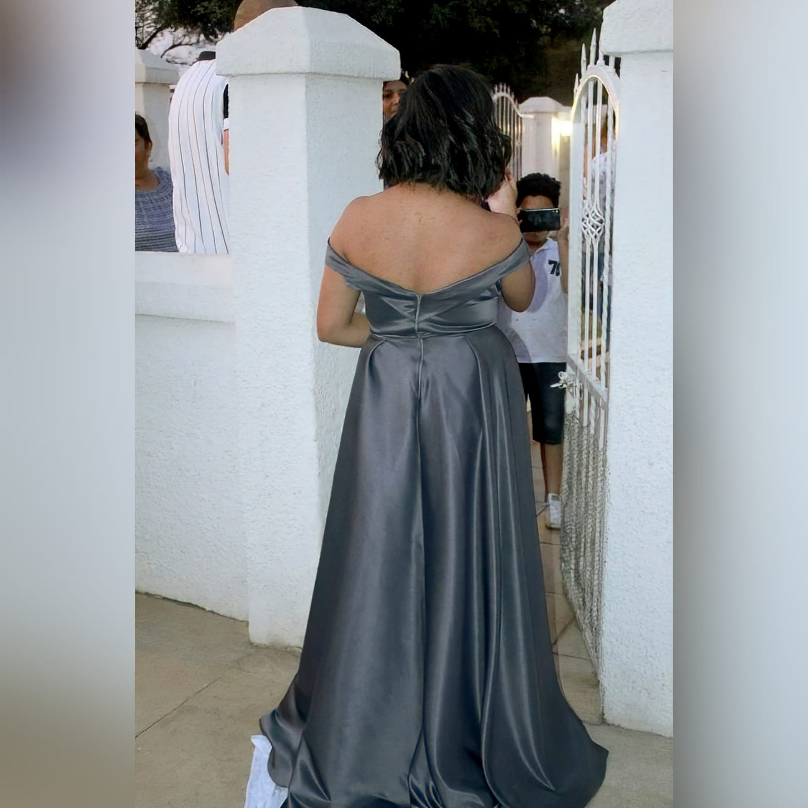 Elegant classic plus size prom dress in grey 4 an elegant classic plus size prom dress design, custom made for khiara. Off-shoulder gorgeous v neckline, fitted till the waist, with a full rich long bottom with a high slit. A removable belt with a touch of silver adding a finish to this stunning look.