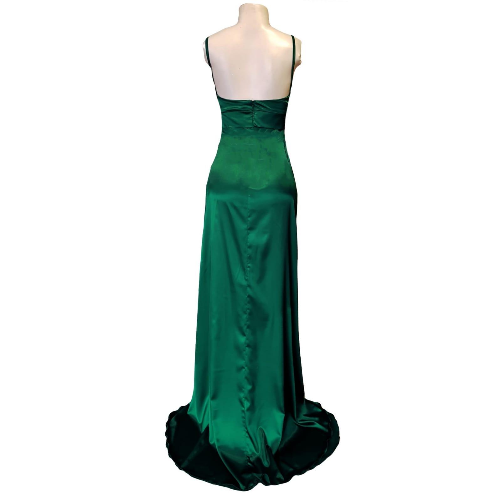 Emerald green long satin prom dress 4 emerald green long satin prom dress. With a high crossed slit and a train.