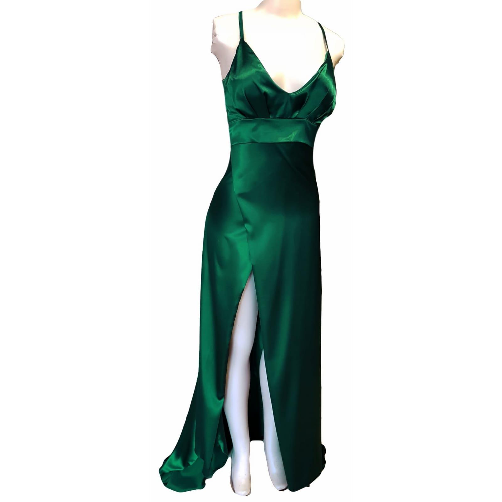 Emerald green long satin prom dress 5 emerald green long satin prom dress. With a high crossed slit and a train.