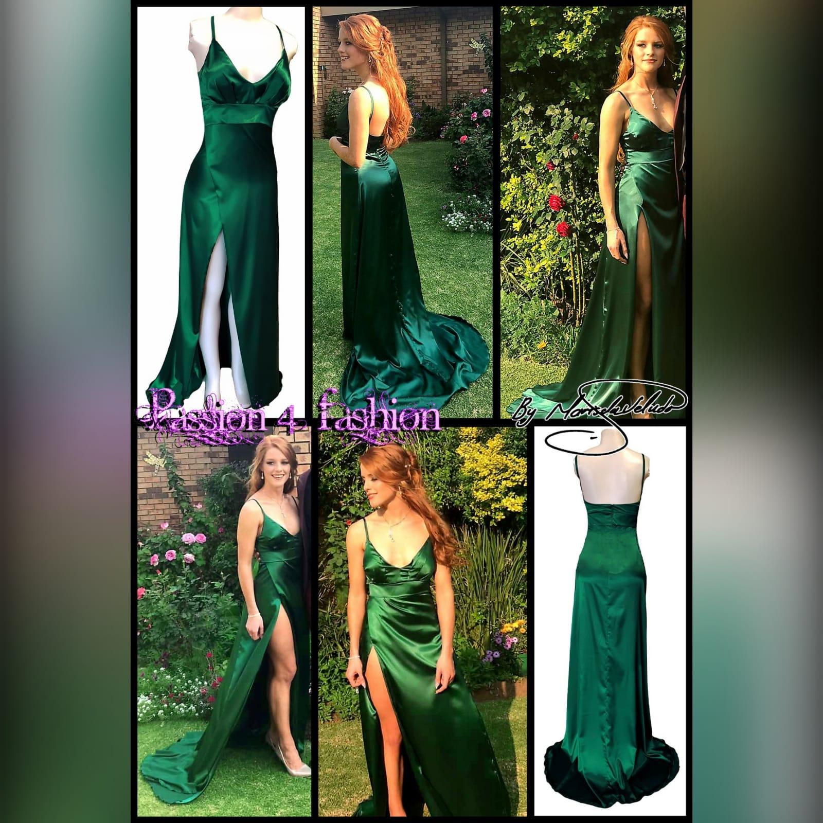 Emerald green long satin prom dress 6 emerald green long satin prom dress. With a high crossed slit and a train.
