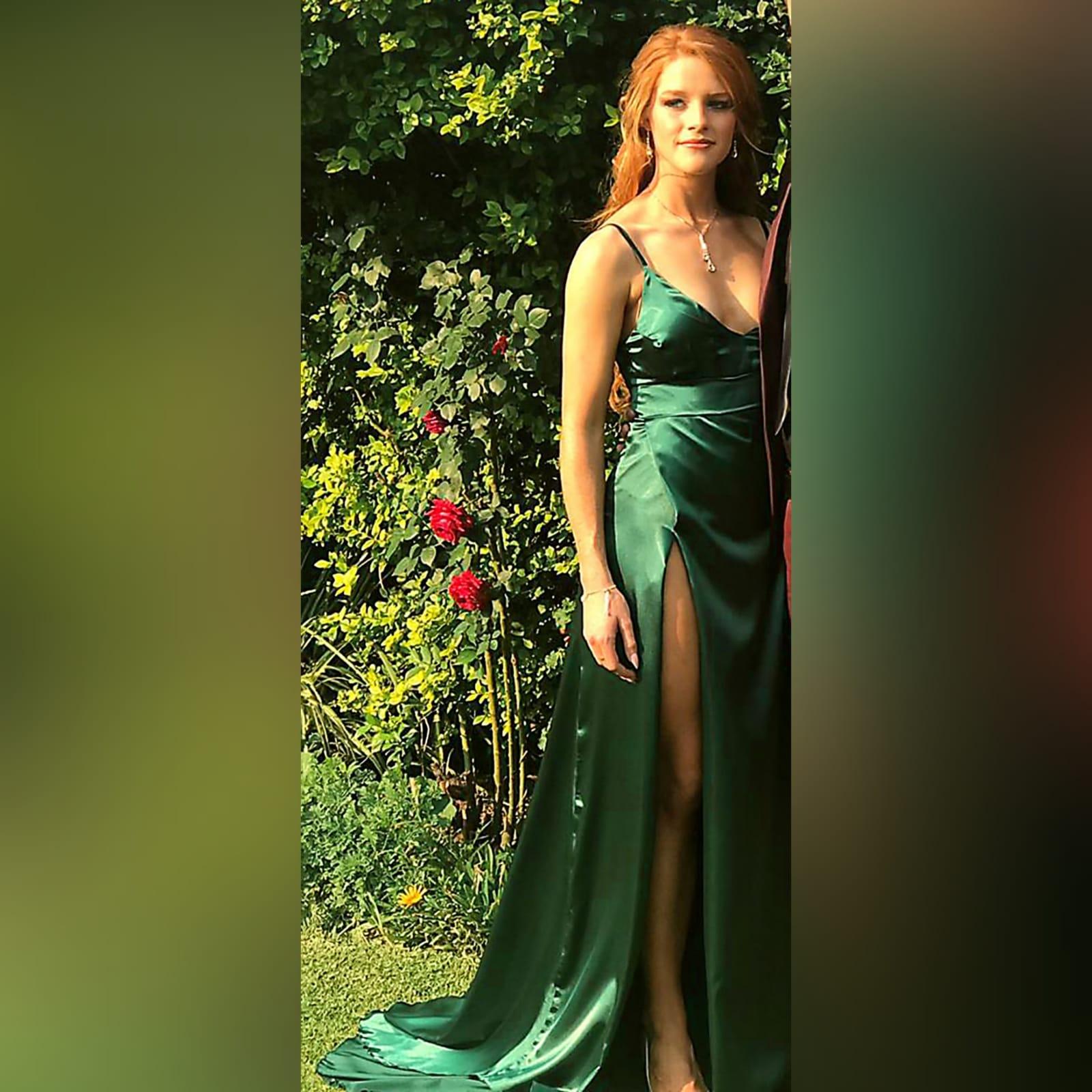 Emerald green long satin prom dress 3 emerald green long satin prom dress. With a high crossed slit and a train.