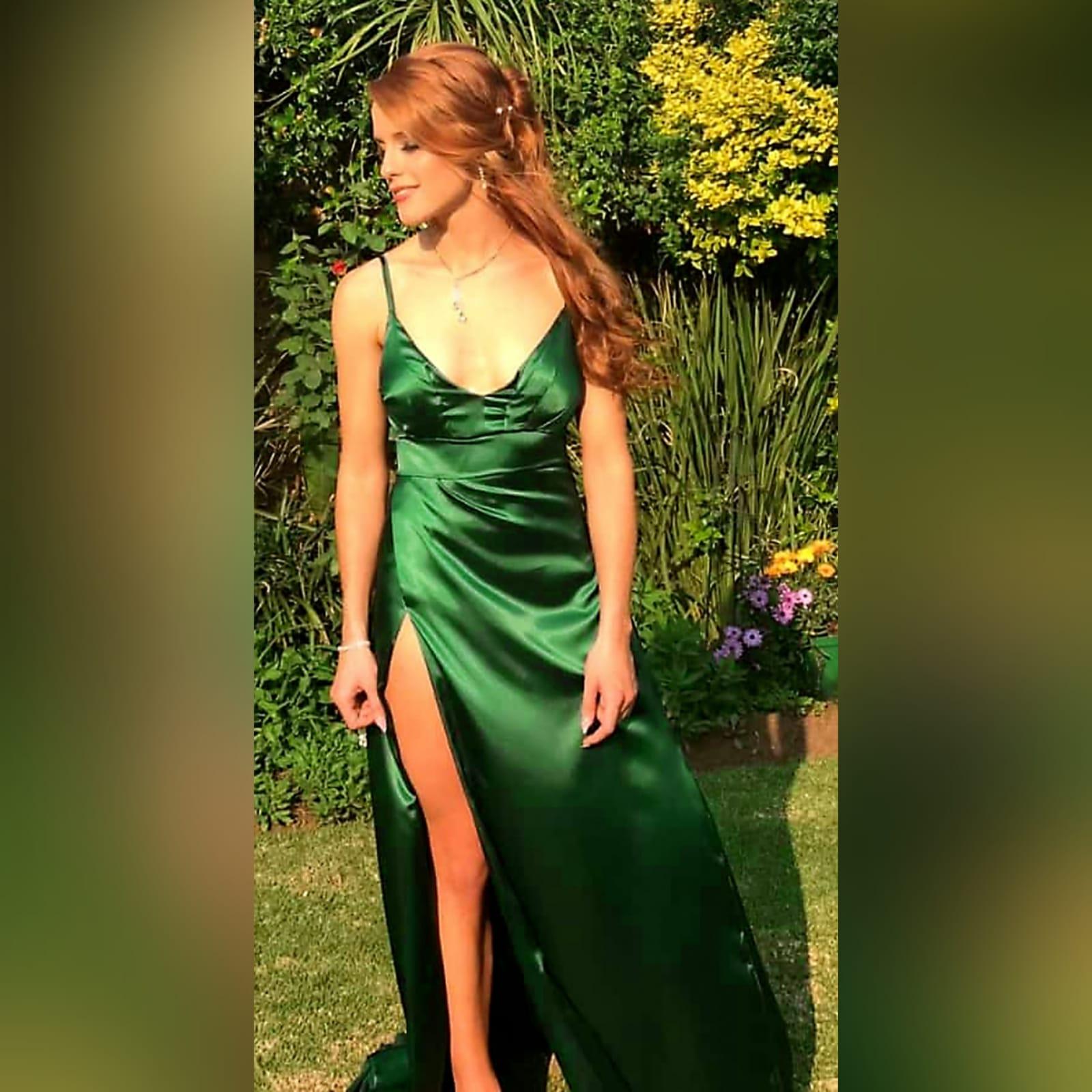 Emerald green long satin prom dress 1 emerald green long satin prom dress. With a high crossed slit and a train.