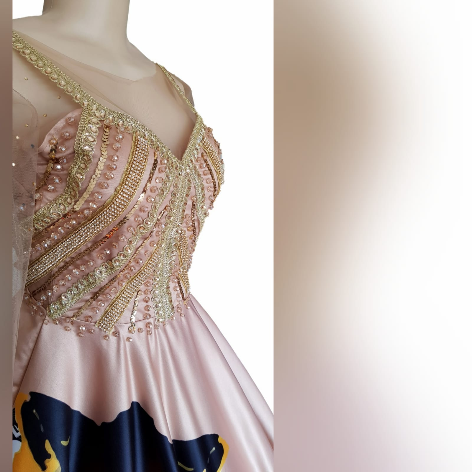 Gold ball gown for beauty pageant 3 gold ball gown for beauty pageant, bodice detailed in gold beadwork with sheer long sleeves, with a v open back. With traditional kaleidoscope print