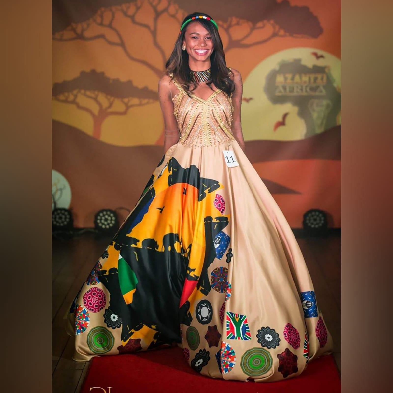 Gold ball gown for beauty pageant 5 gold ball gown for beauty pageant, bodice detailed in gold beadwork with sheer long sleeves, with a v open back. With traditional kaleidoscope print