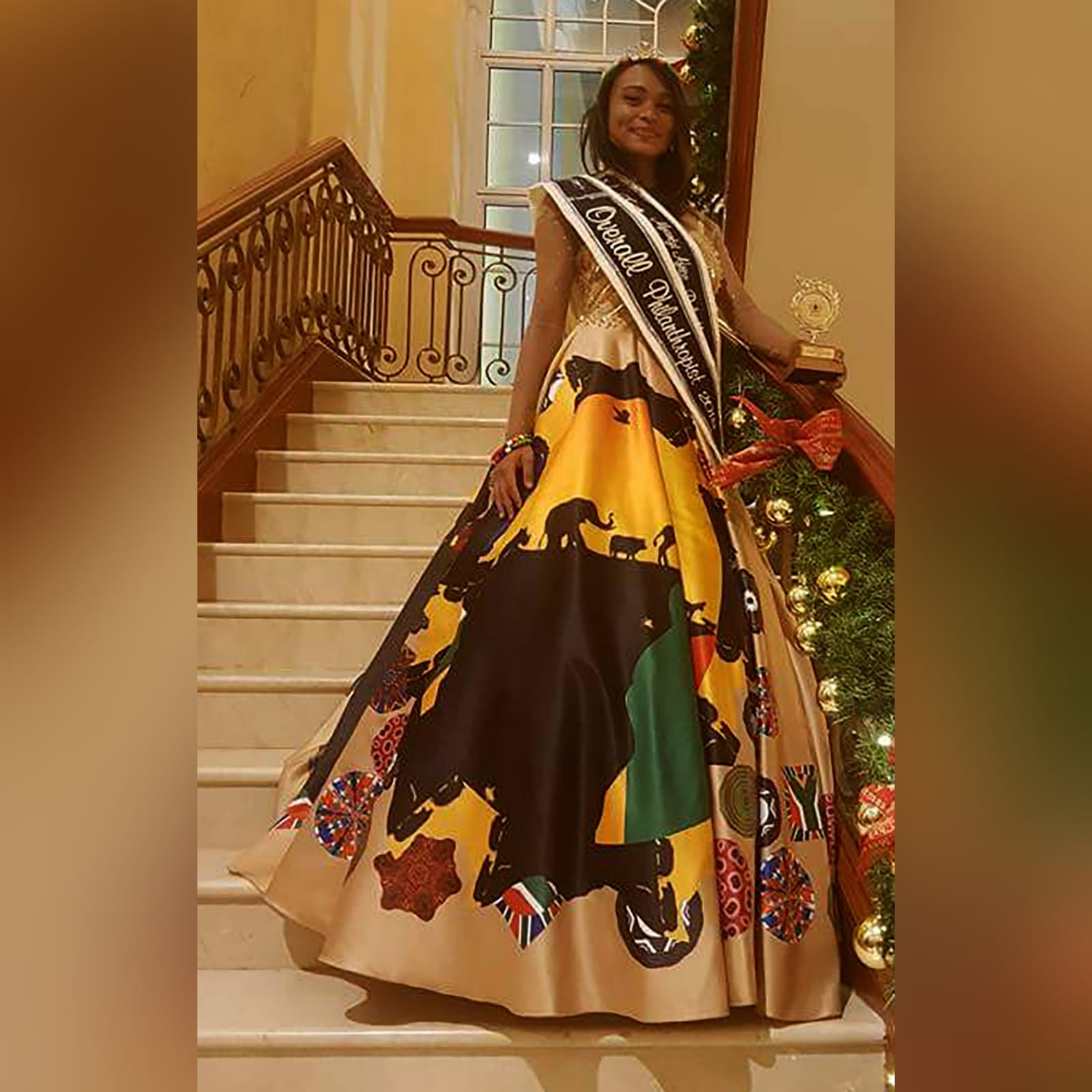 Gold ball gown for beauty pageant 6 gold ball gown for beauty pageant, bodice detailed in gold beadwork with sheer long sleeves, with a v open back. With traditional kaleidoscope print