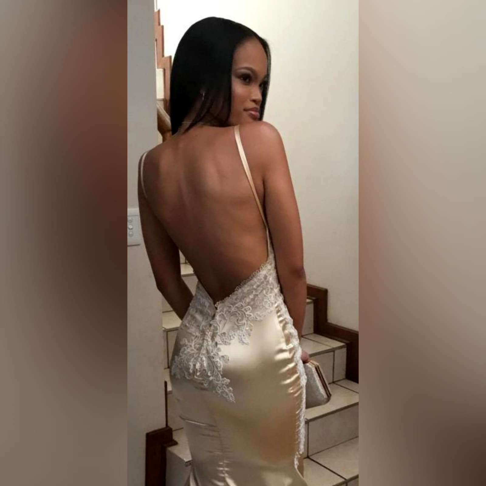 Gold satin soft mermaid matric farewell dress 3 gold satin soft mermaid matric farewell dress with a v neckline, a naked back and long train. Bodice hips and back detailed with lace.
