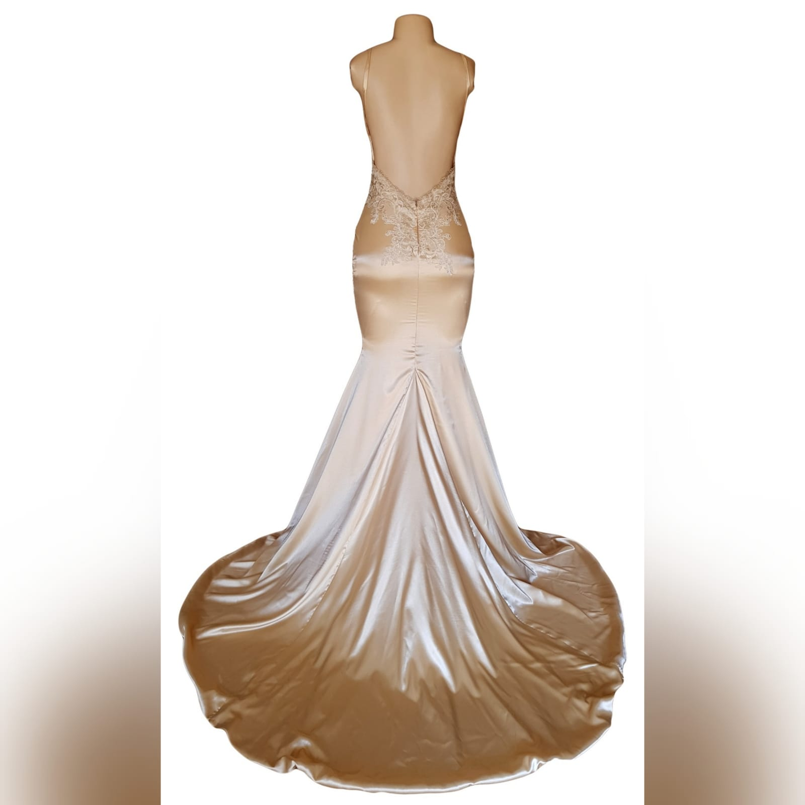 Gold satin soft mermaid matric farewell dress 5 gold satin soft mermaid matric farewell dress with a v neckline, a naked back and long train. Bodice hips and back detailed with lace.