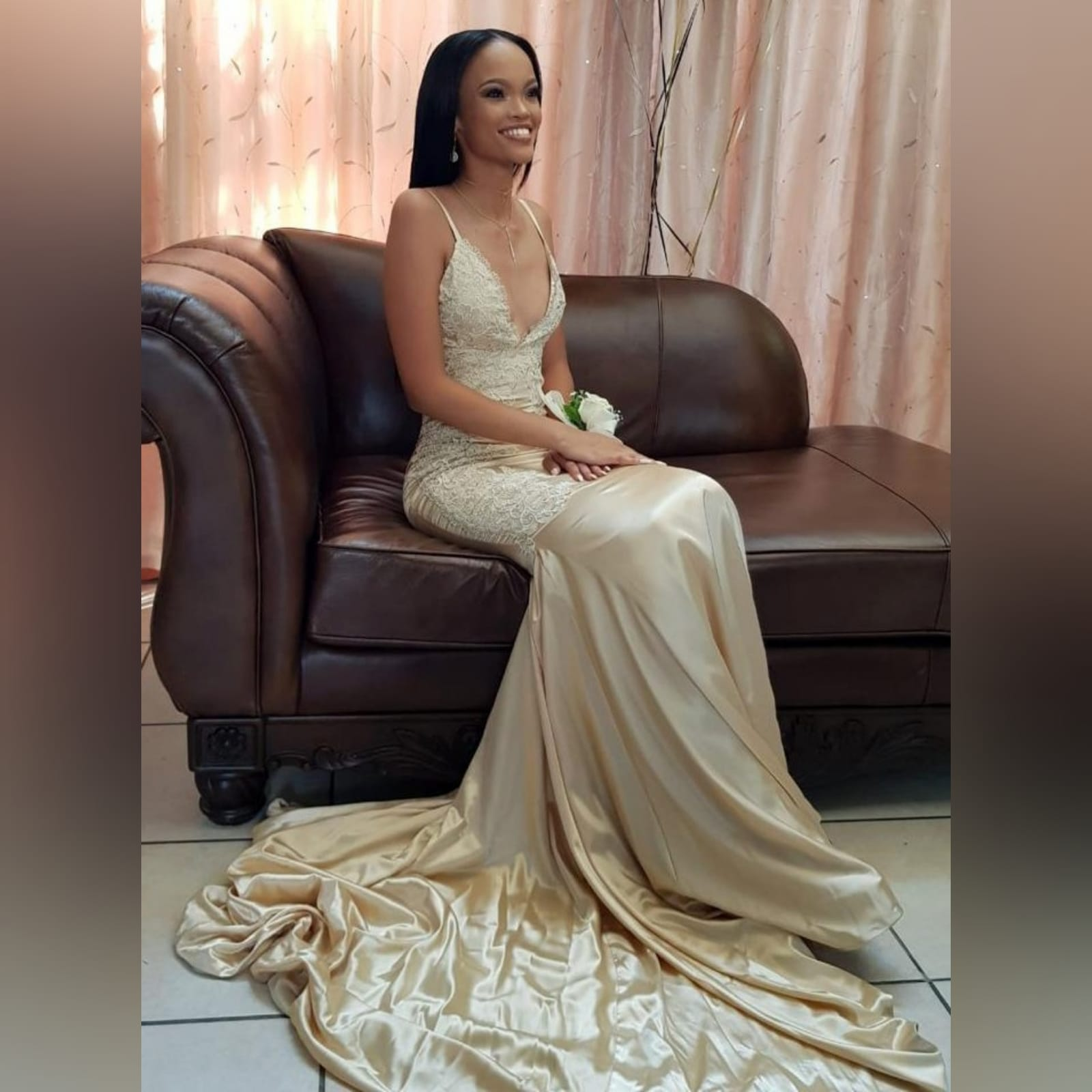 Gold satin soft mermaid matric farewell dress 1 gold satin soft mermaid matric farewell dress with a v neckline, a naked back and long train. Bodice hips and back detailed with lace.