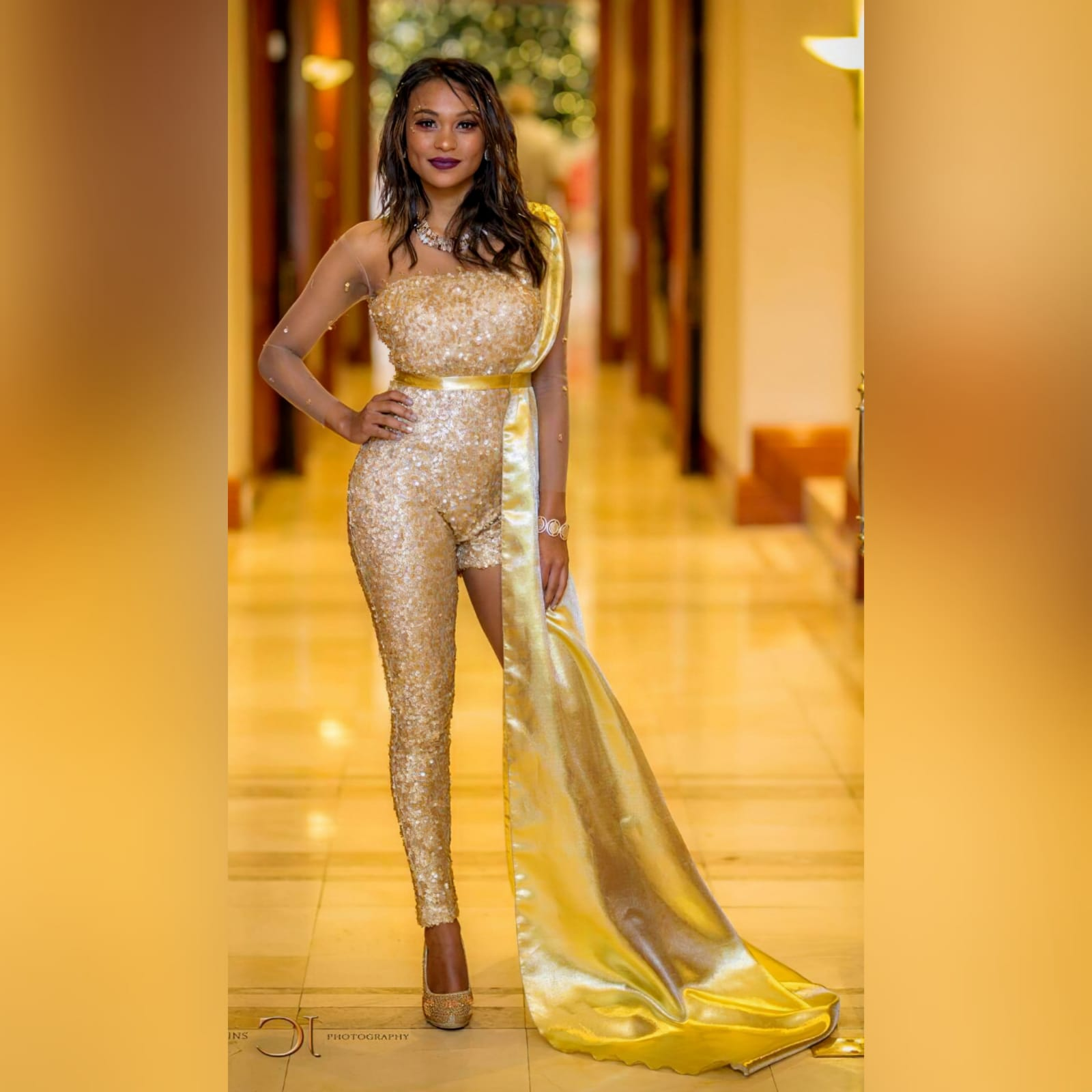 Gold sequins evening wear bodysuit 1 gold sequins evening wear bodysuit with an illusion neckline and sleeves, detailed with gold beads. With a long and short leg. Detachable side gold train.