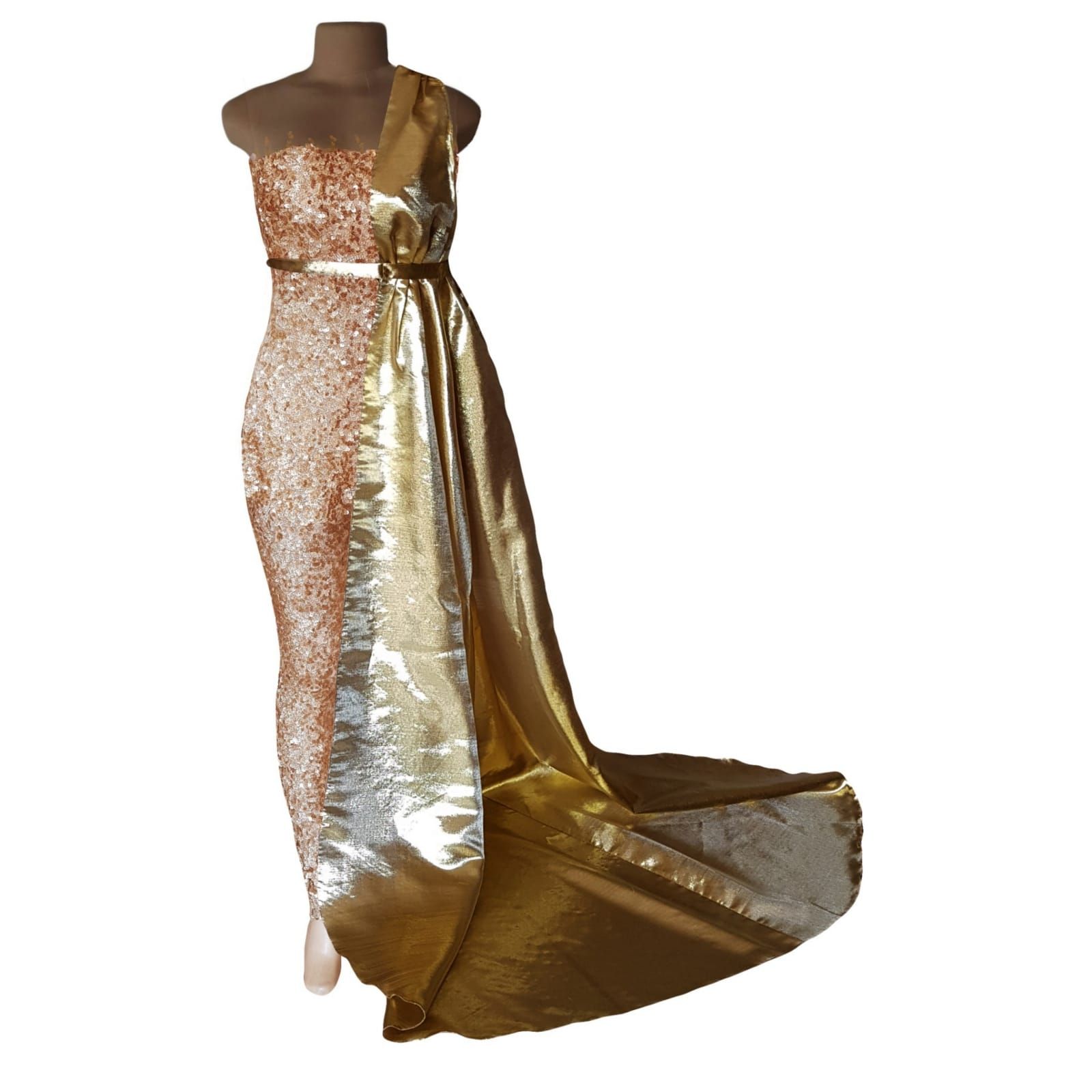 Gold sequins evening wear bodysuit 4 gold sequins evening wear bodysuit with an illusion neckline and sleeves, detailed with gold beads. With a long and short leg. Detachable side gold train.